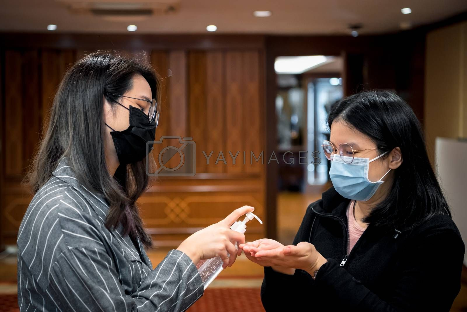 Asian women wearing mask and alcohol antibacterial hand gel respiratory protection mask against epidemic flu covid19 or corona virus with fear emotion in concept illness, outbreak, healthcare in life