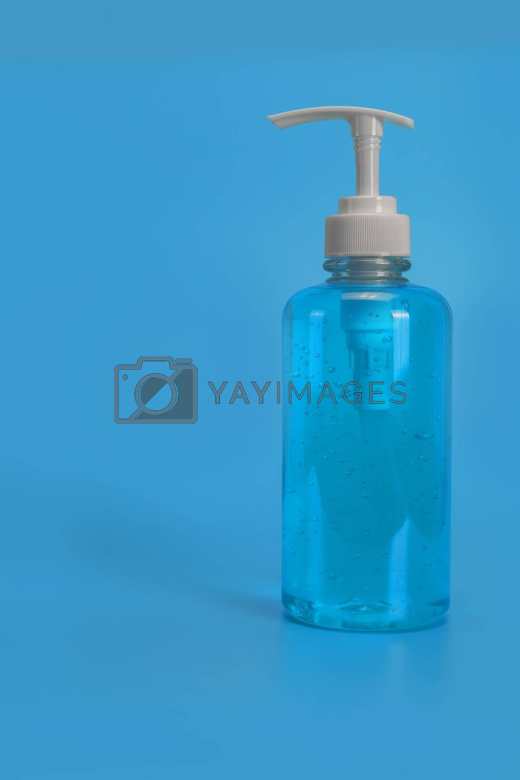 Blue alcohol gel isolated on blue background. Hand sanitizer gel for clean. Hand sanitizer in pump head bottle. with copy space.