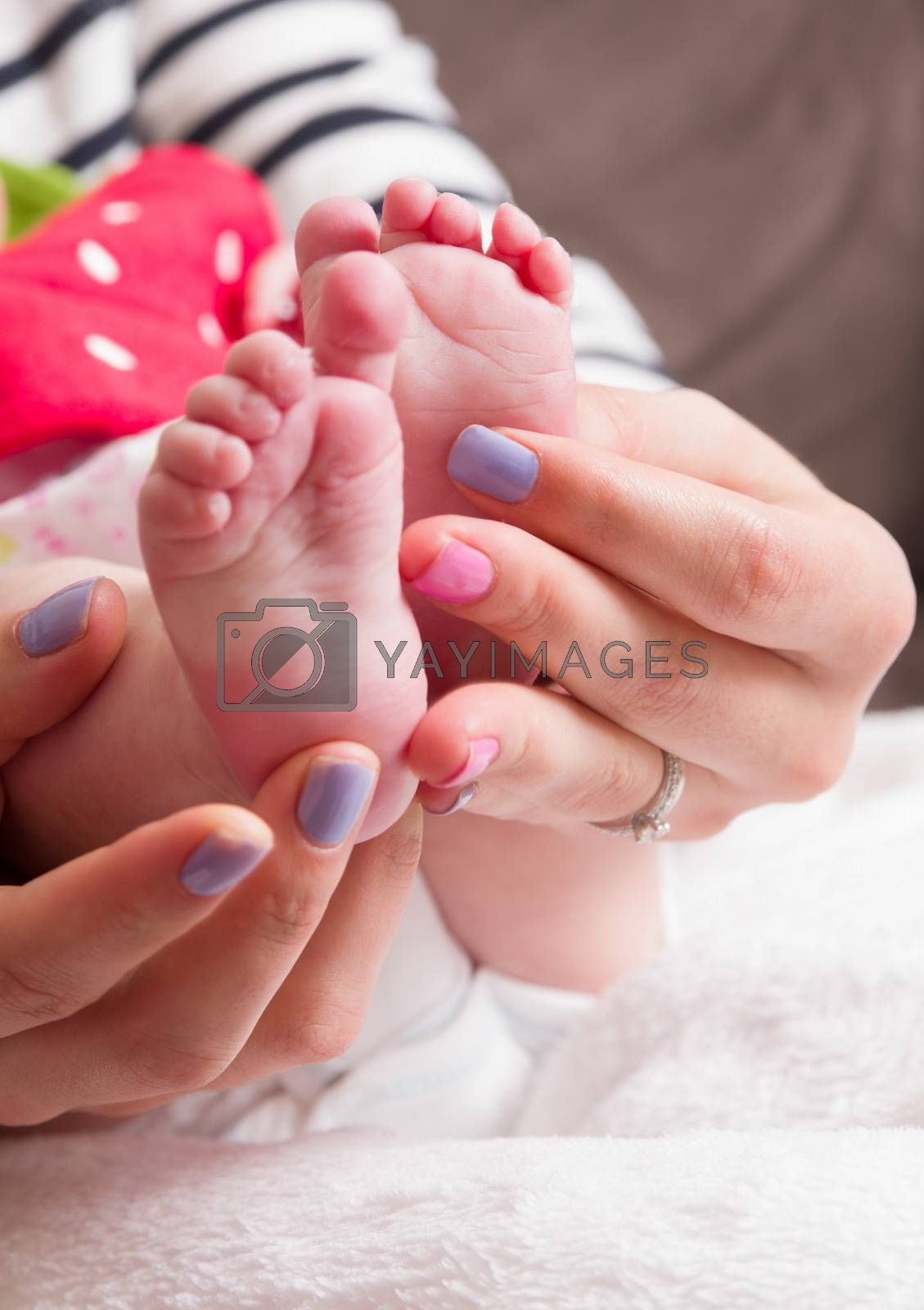 small baby legs in mother hands