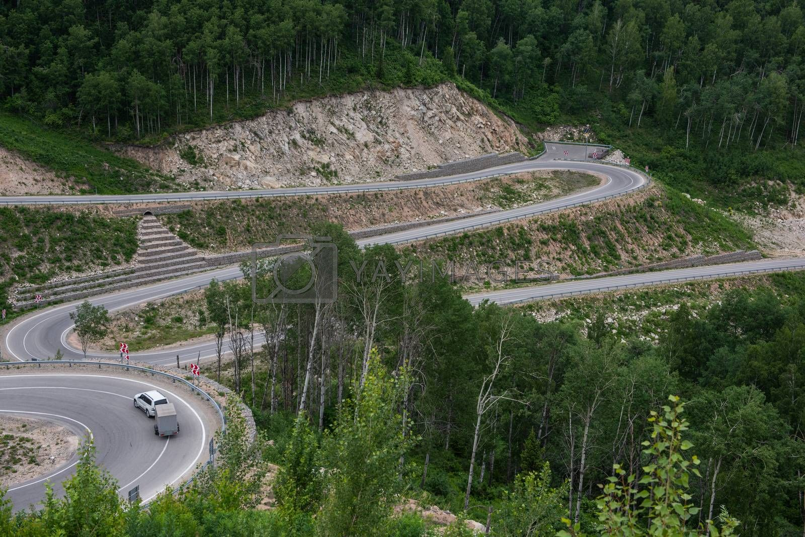 Royalty free image of Winding road in the mountains by rusak