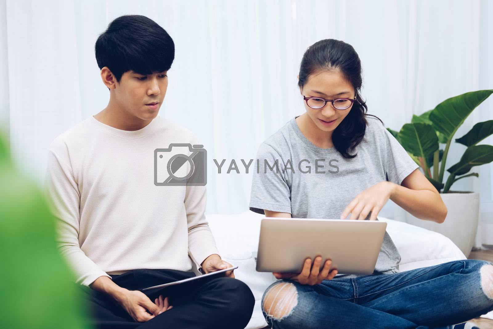 man woman friends using computer tablet. startup teamwork team working together at home