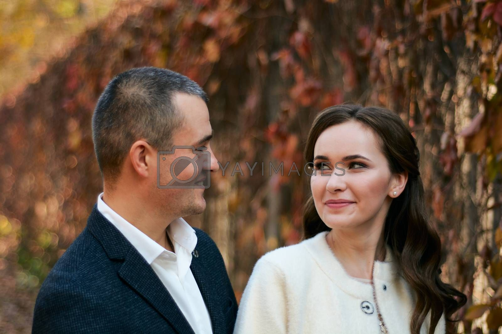 Couple in love close-up portrait. Young male and woman just married. Concept of happy family. Modern family outdoor.