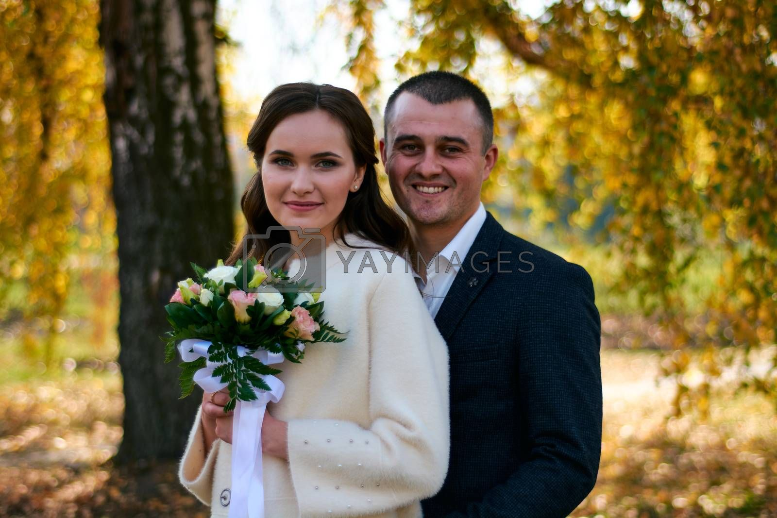 Couple in love close-up portrait. Young male and woman just married. Concept of happy family. Modern family outdoor. Adorable family demonstrate love and care. Autumn vacation.