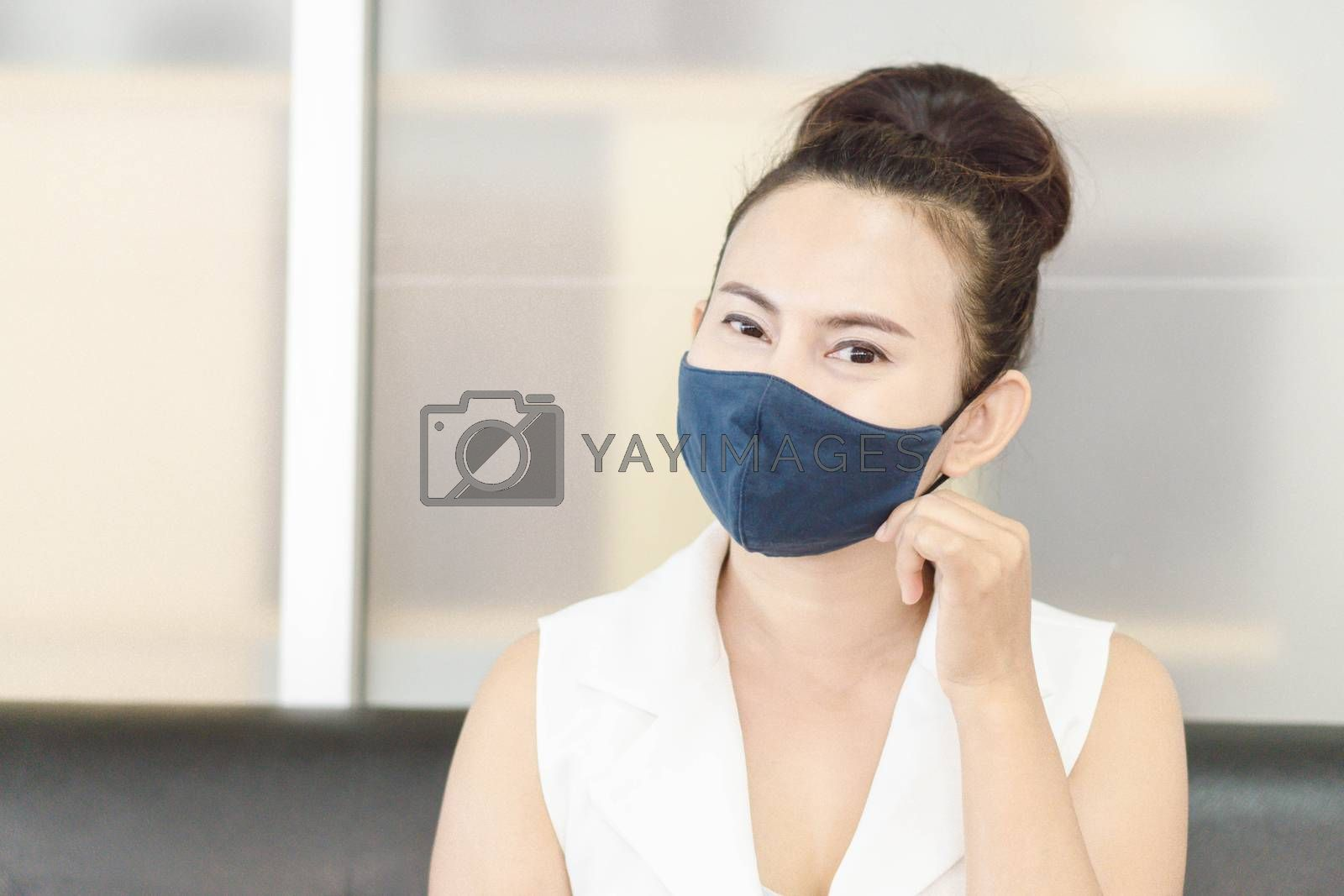 Closeup asian woman wearing face mask for protect air polution or virus covid 19, health care and medical concept