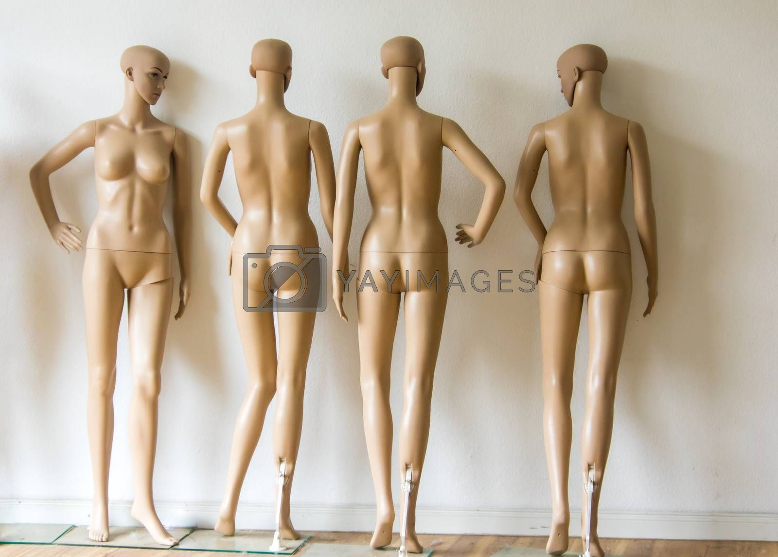 group of undressed mannequins in a shop in Berlin