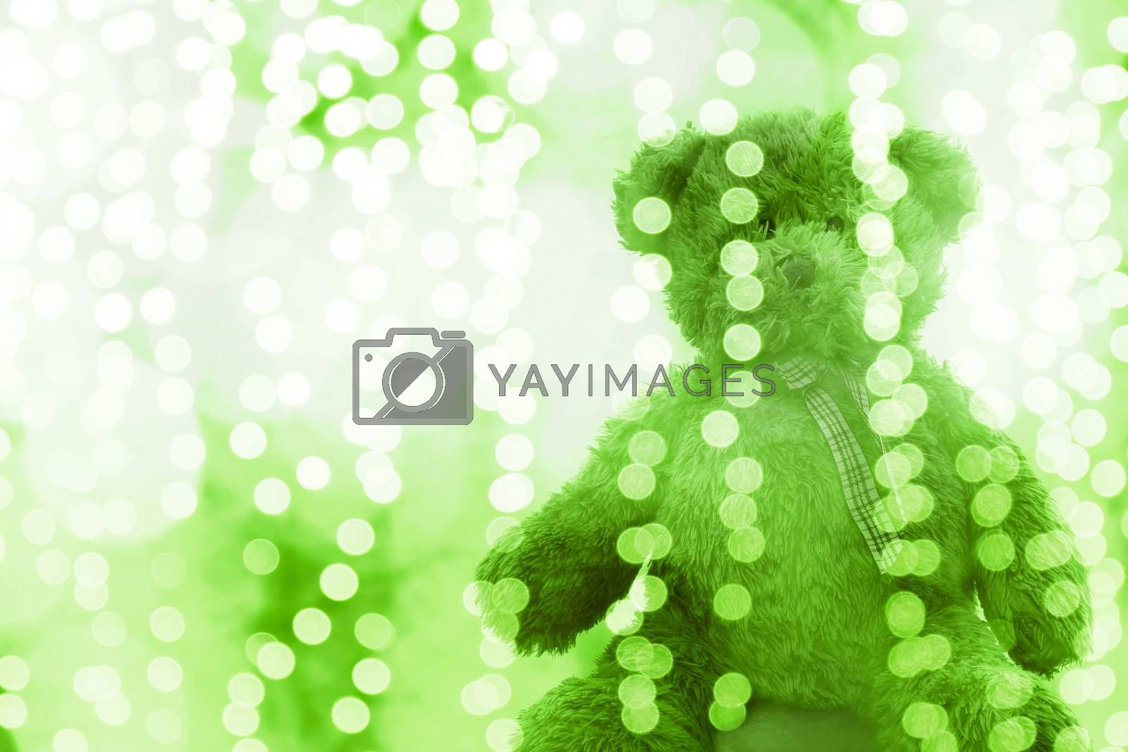 Teddy bear doll in Lighting line bokeh green white bright for Christmas or happy new year Background, Bear in glitter Green background Blurred bokeh bright (Selective Focus)
