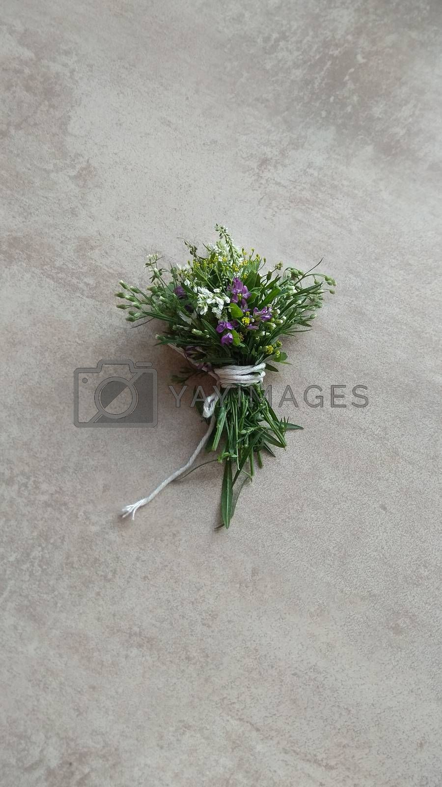 Festive wild flowers composition on the grey background. Overhead view.