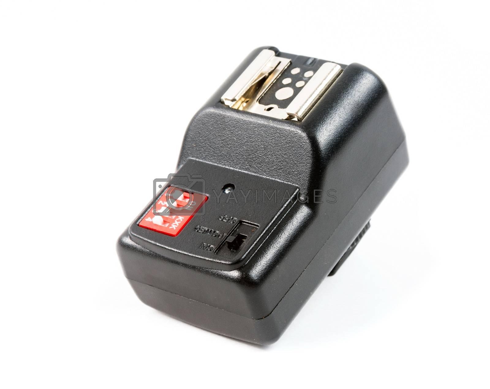 Black studio flash transmitter on the white