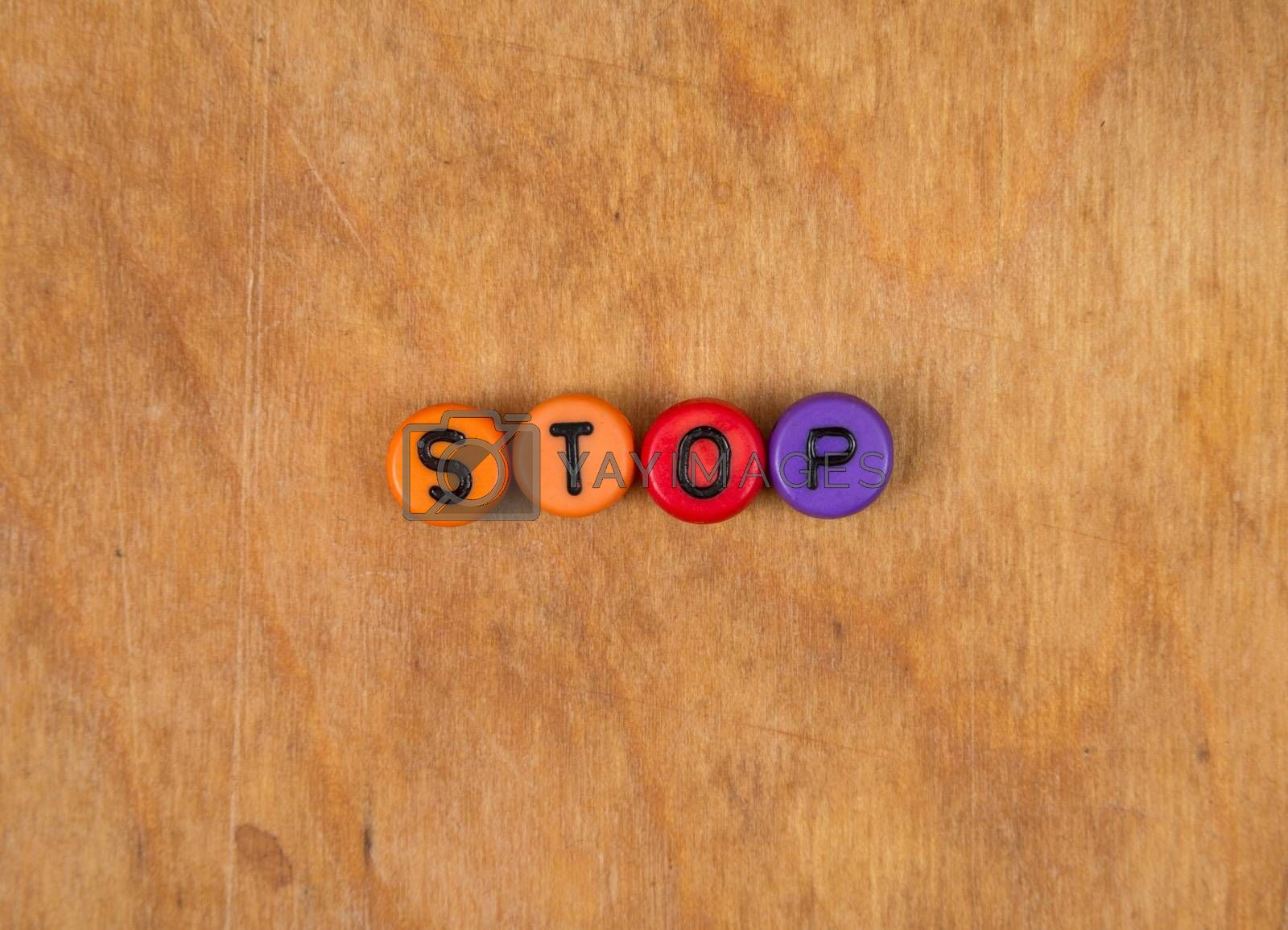stop- cube words on the wooden table