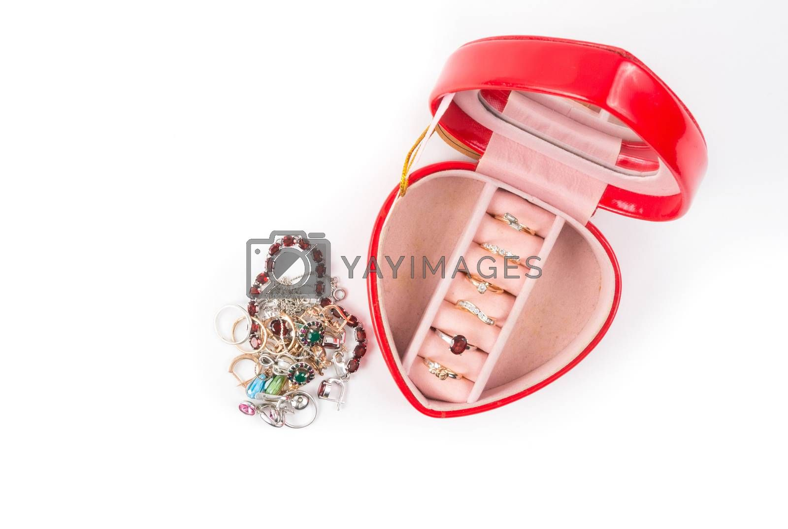Red gift box in heart shape with rings