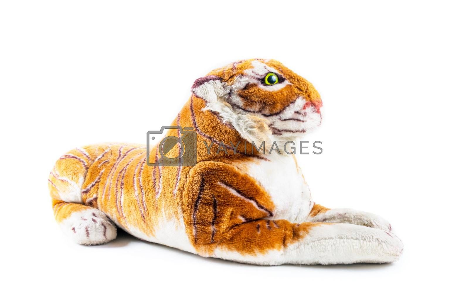Tiger toy sitting on the white