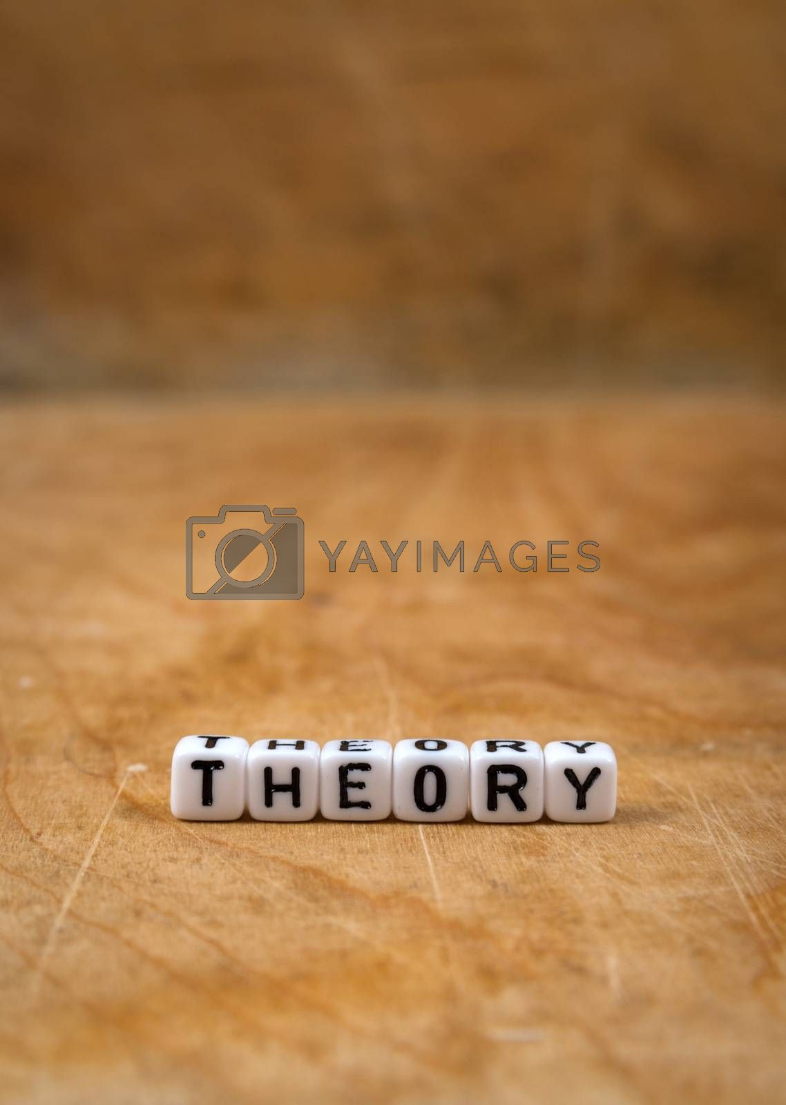 Royalty free image of cube words on the wooden table by gmstockstudio