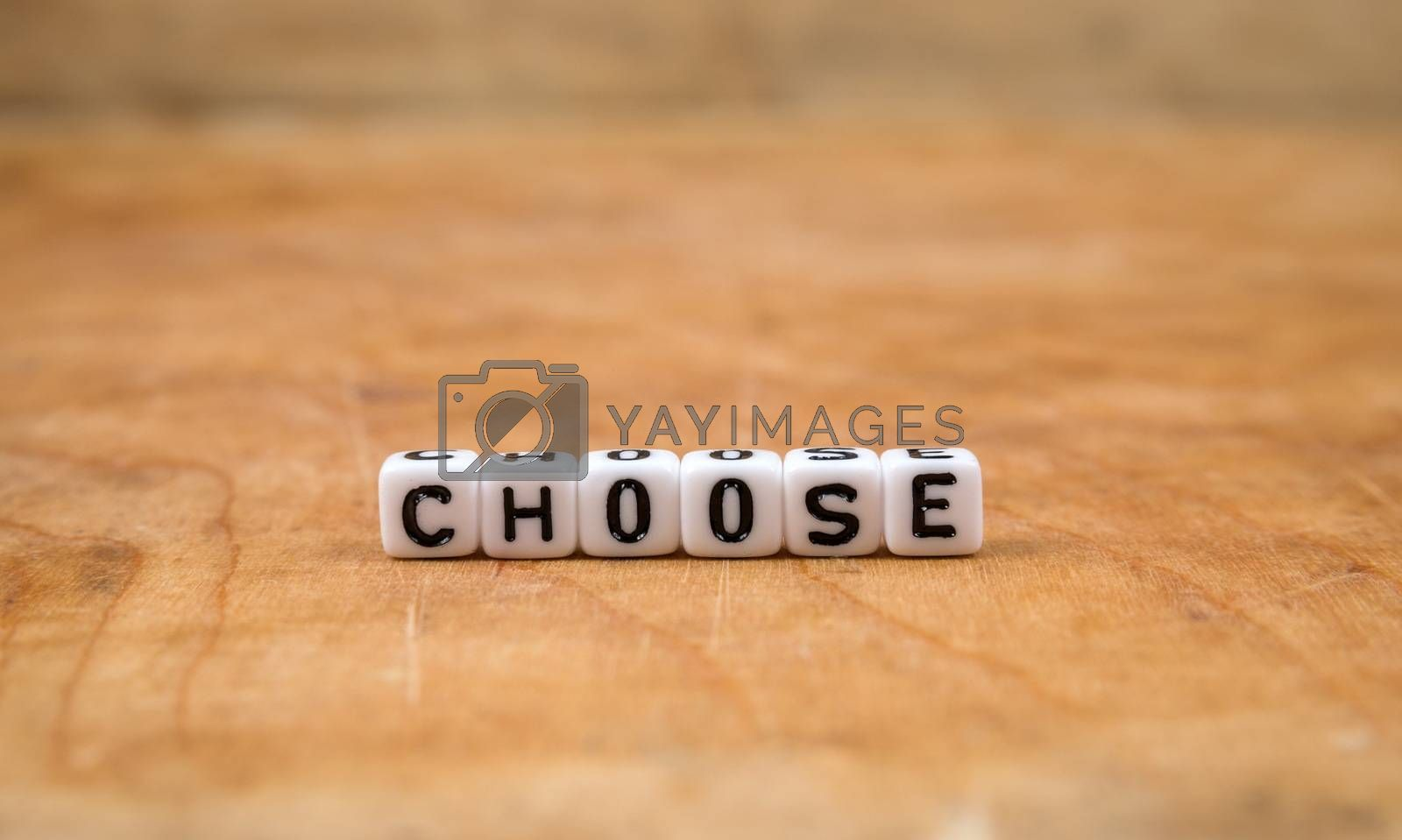 cube words on the wooden table by gmstockstudio