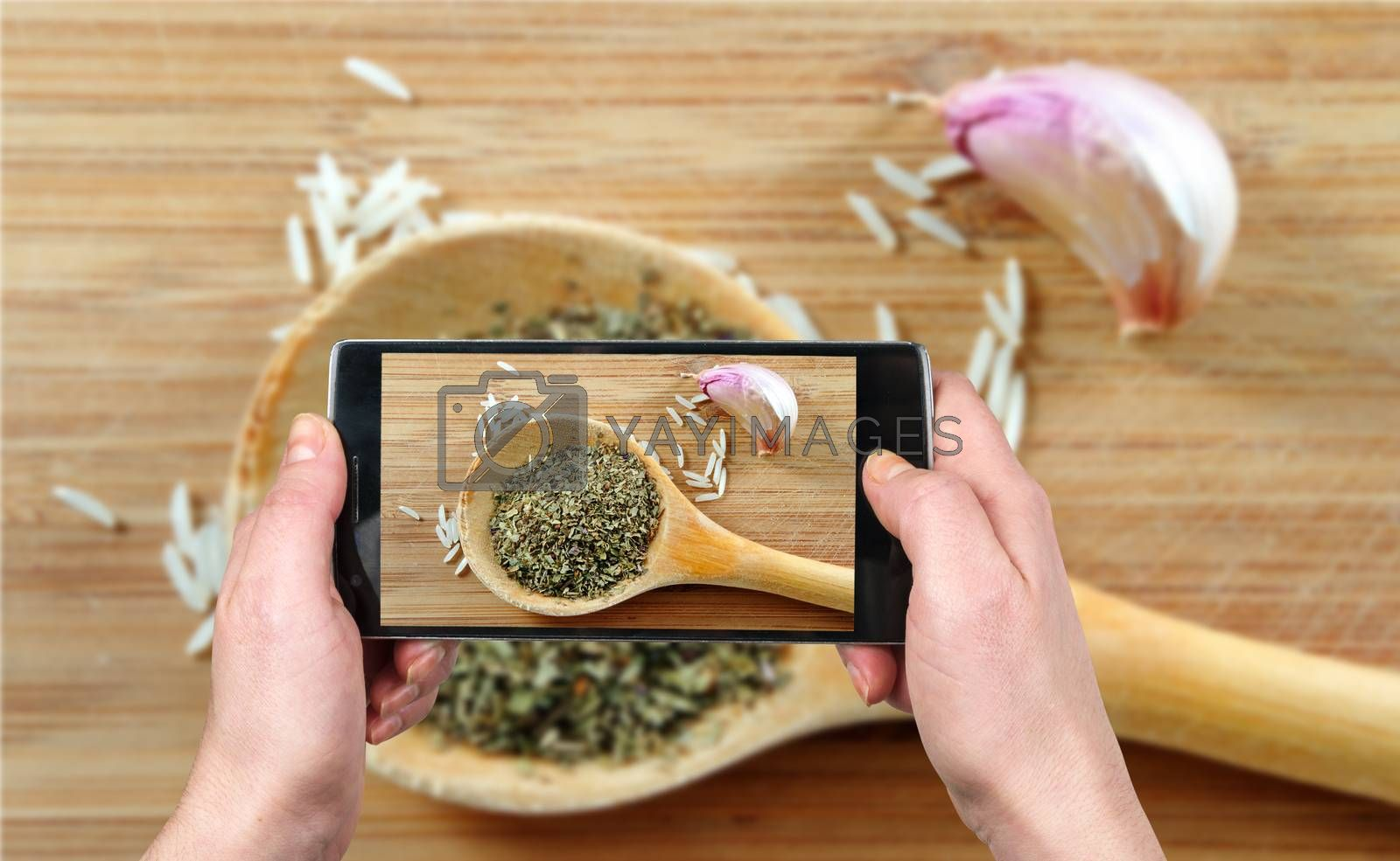 Royalty free image of Taking picture of food with the phone by gmstockstudio