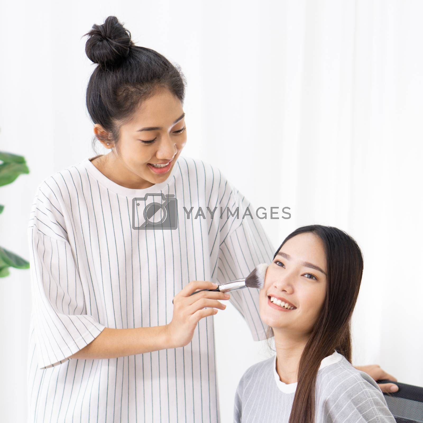 Roommates have fun learning to make-up for asian friends.