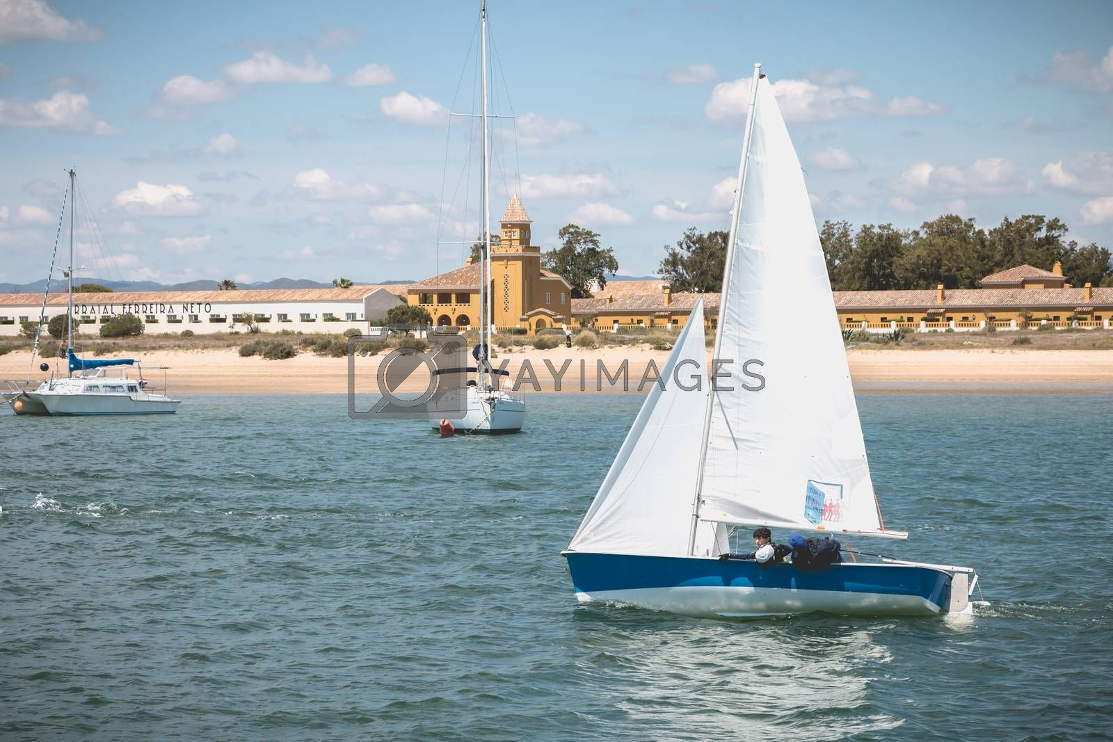 Tavira Island, Portugal - May 3, 2018: People dressed as sailor taking a boat lesson on the Ria Formosa lagoon on a spring day
