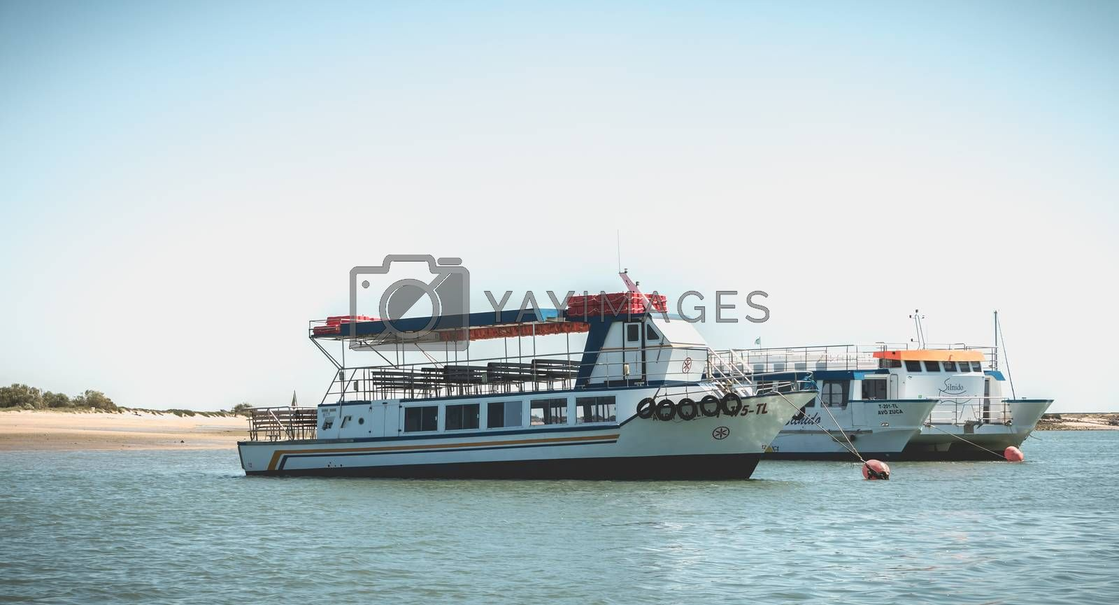 Royalty free image of Tourist transport boats moored in the lagoons of the Ria Formosa by AtlanticEUROSTOXX