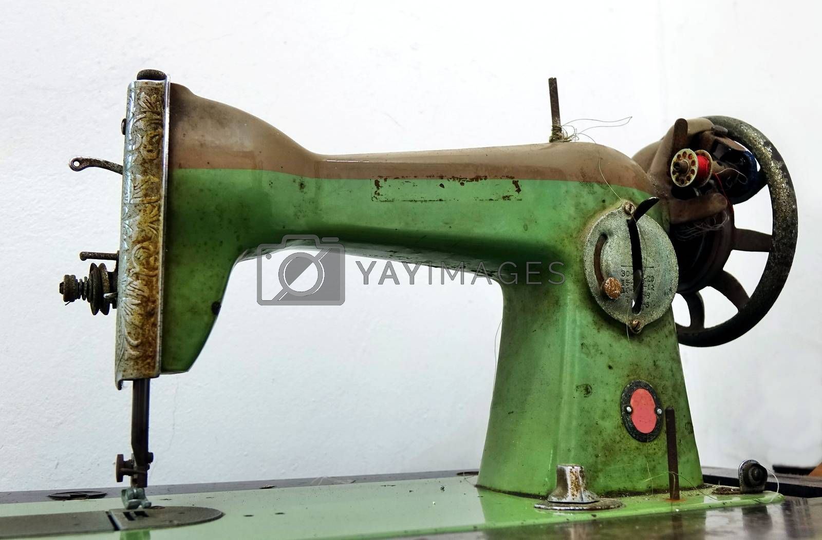 Vintage obsolete sewing machine that is operated by foot