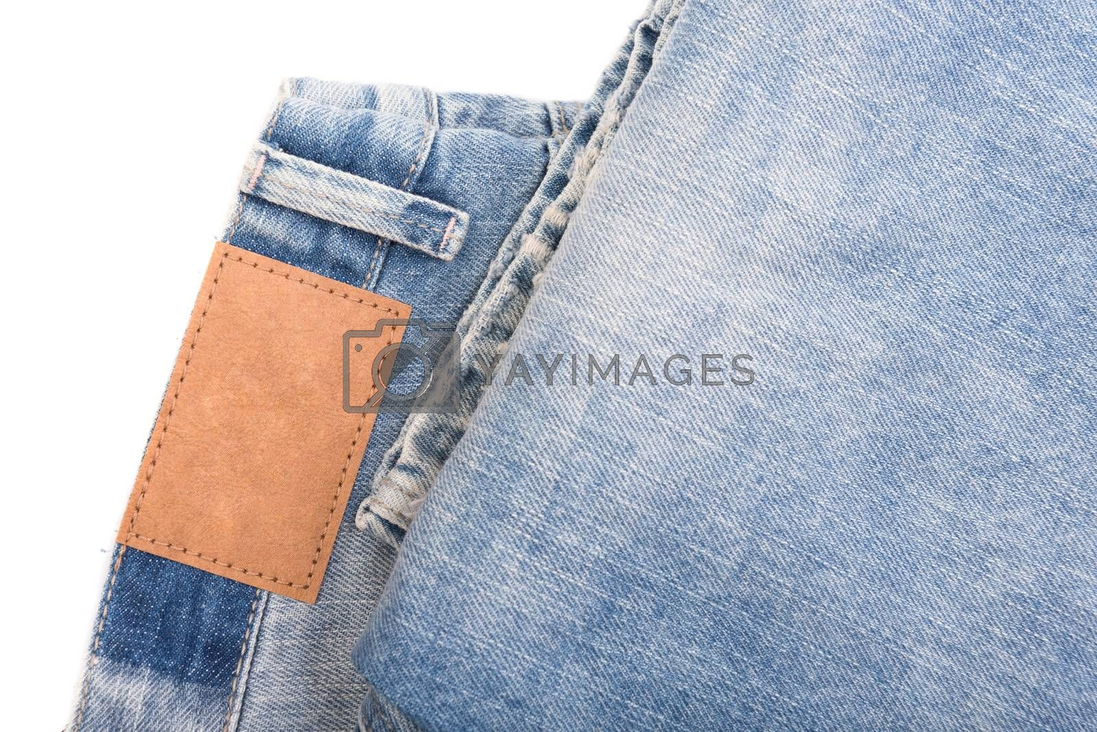 Jeans with leather label isolated on white background