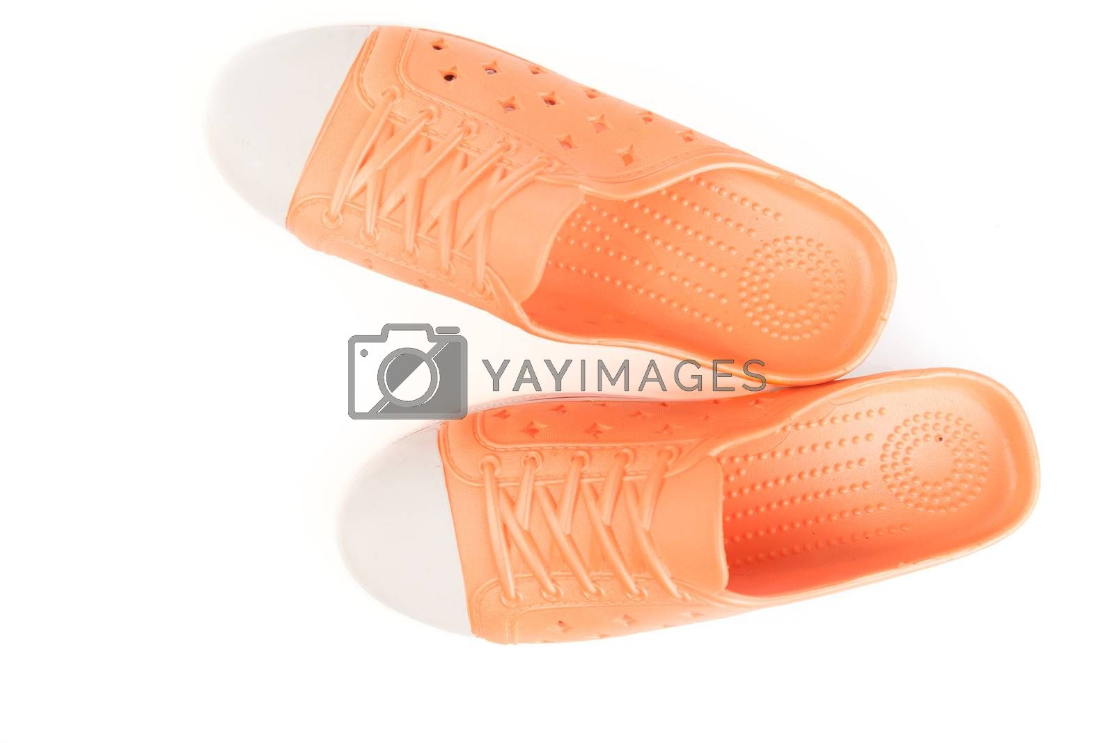 Top view orange shoes isolated on white background