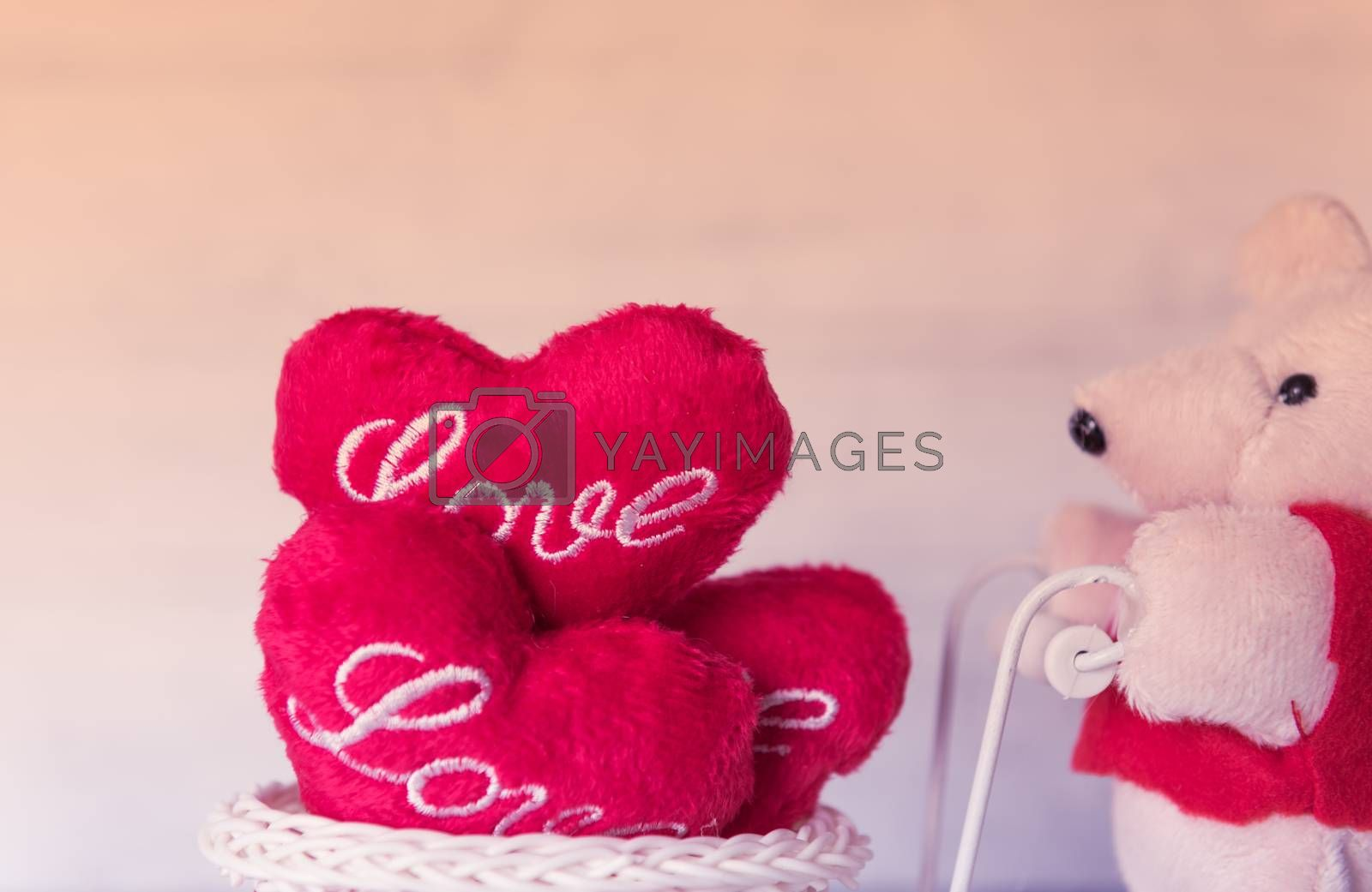 Teddy bear and red hearts with filter vintage effect
