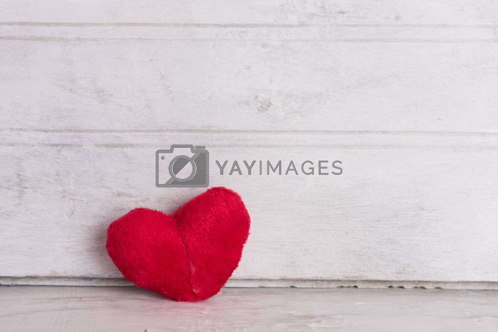 Red heart on wood board