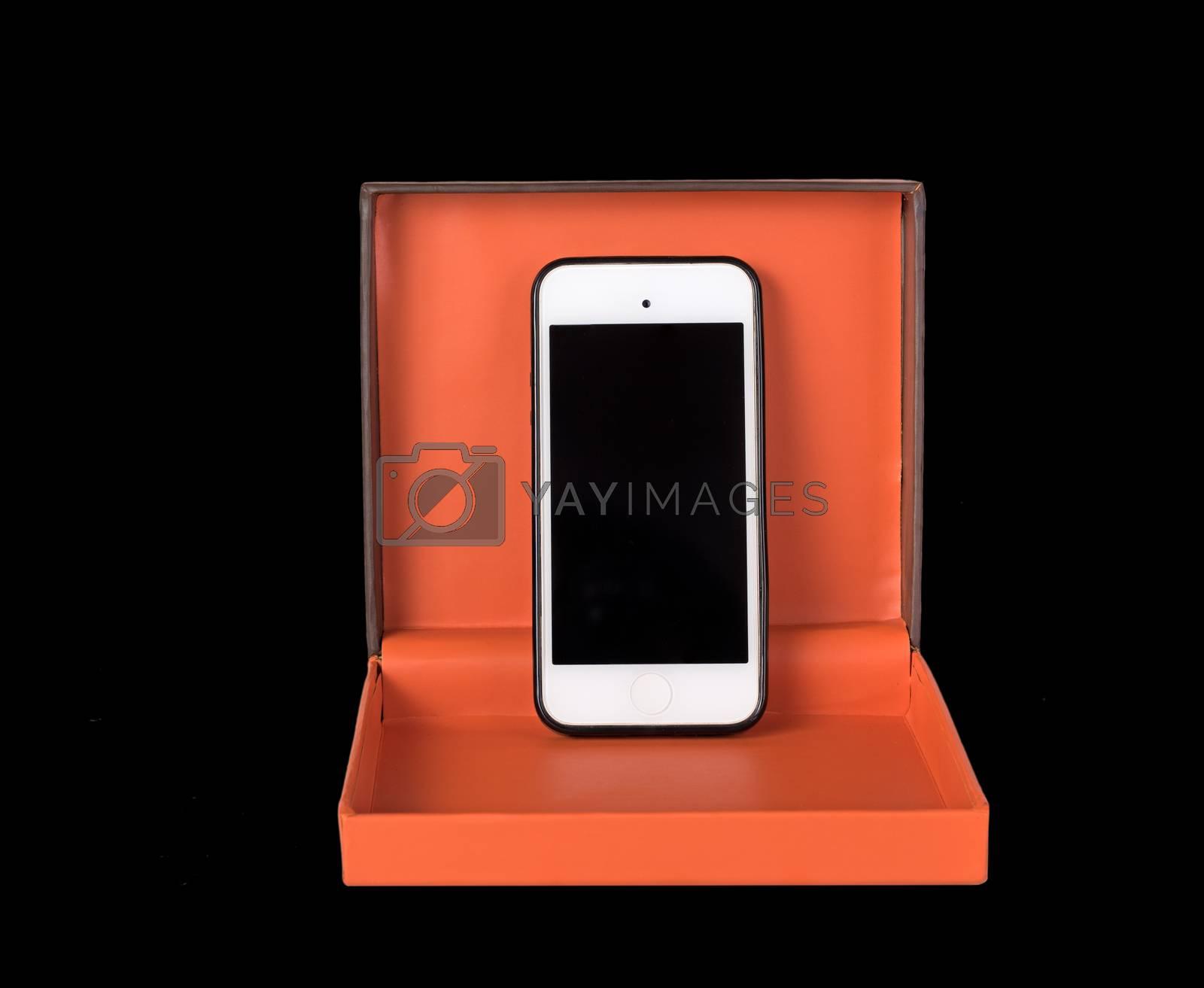 Orange gift box and smartphone isolated on white background