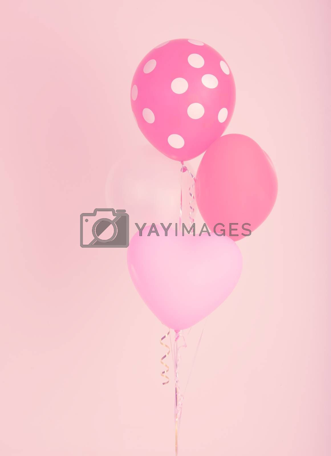 Fastive heart shape balloons on pink wall with vintage filter effect