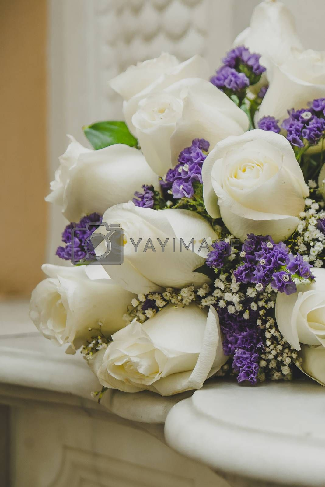 Beautiful wedding bouquet from white roses on wedding day