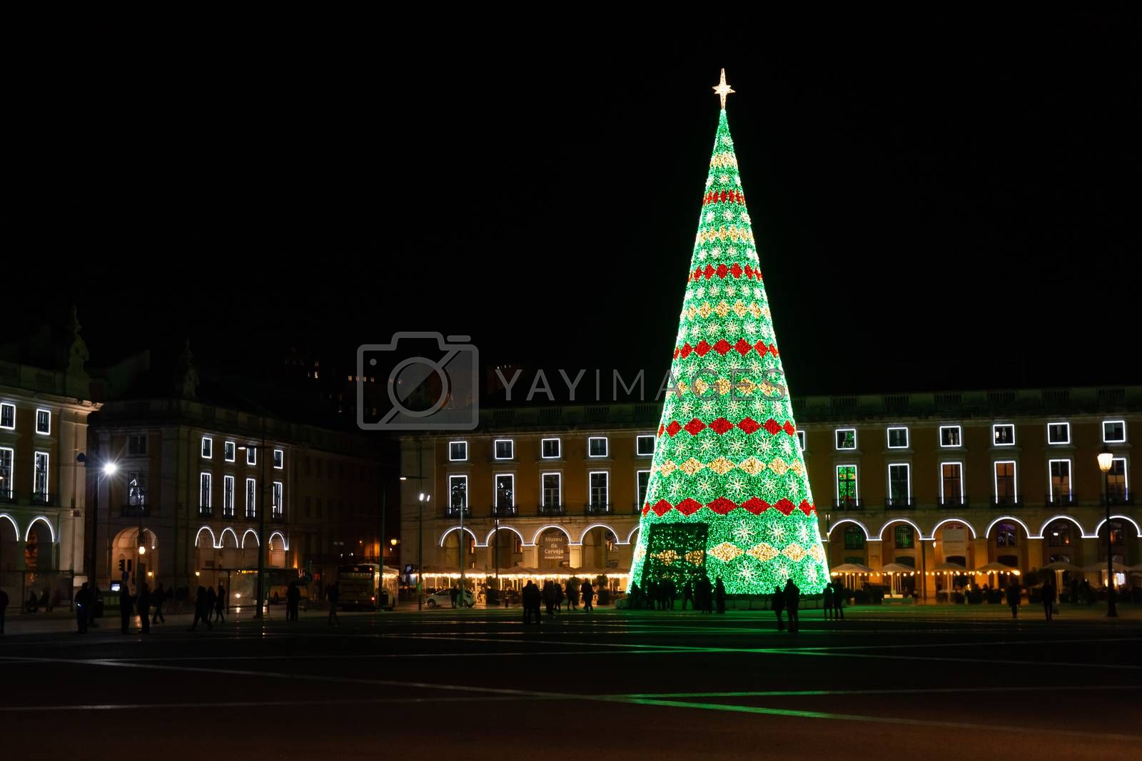 Lisbon, Portugal - November 27, 2018: People Walking Trade Square (Praca do Comercio) Decorated for Christmas by Night on a Fall Day