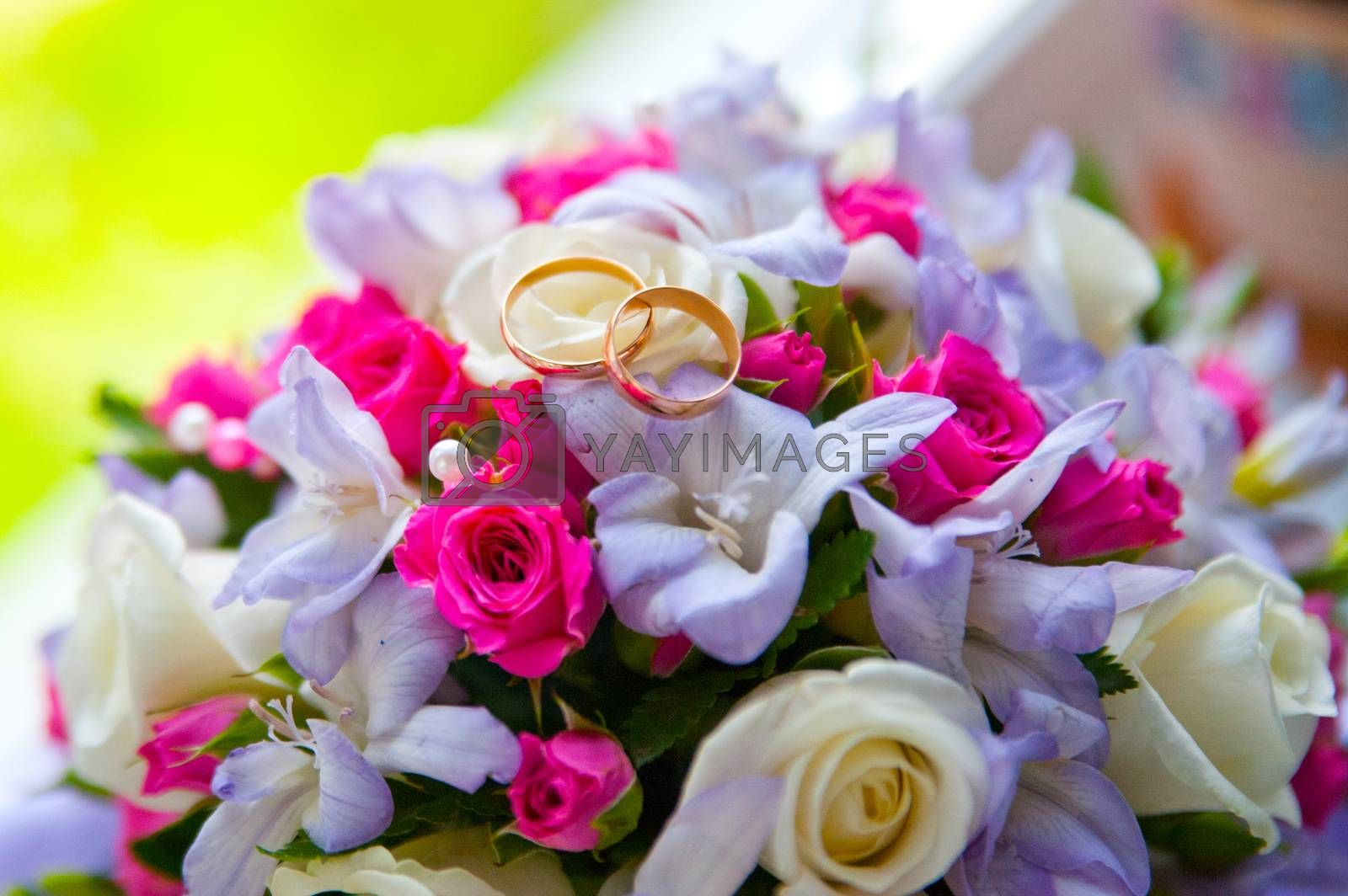 Two beautiful wedding ring about the bride's bouquet on the wedding day