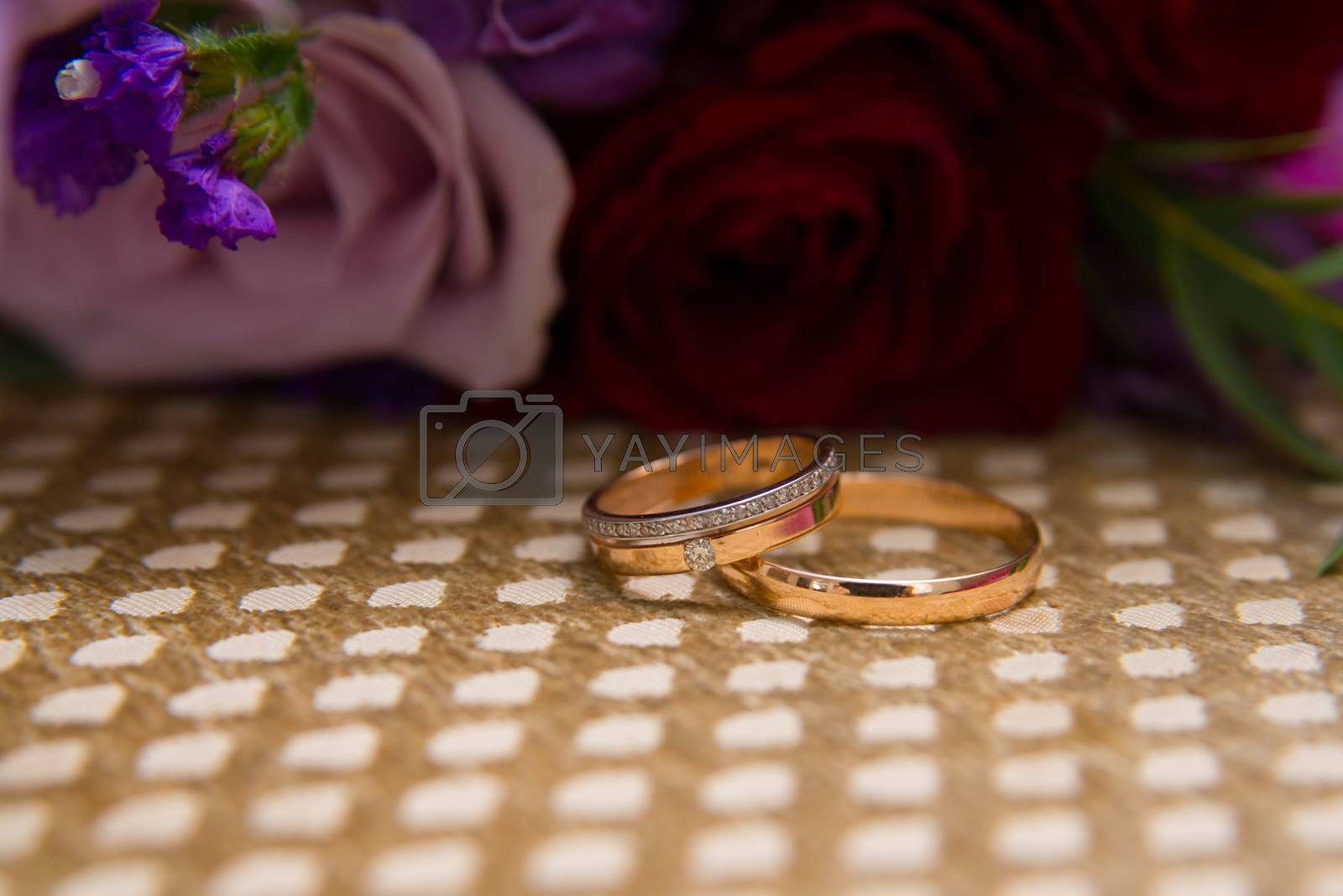 Two gold vintage wedding rings with diamonds bride and groom.