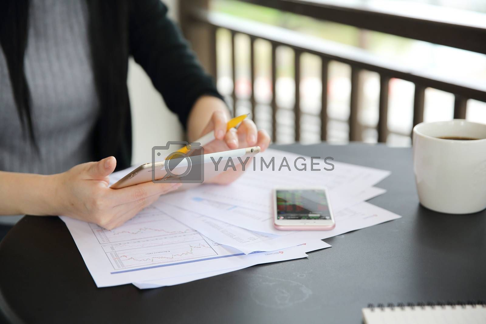 Asian woman with smart phone with business