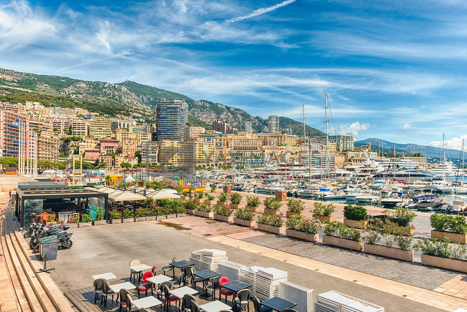 View over luxury yachts and apartments of Port Hercules in La Condamine district, city centre and harbour of Monte Carlo, Cote d'Azur, Principality of Monaco, iconic landmark of the French Riviera