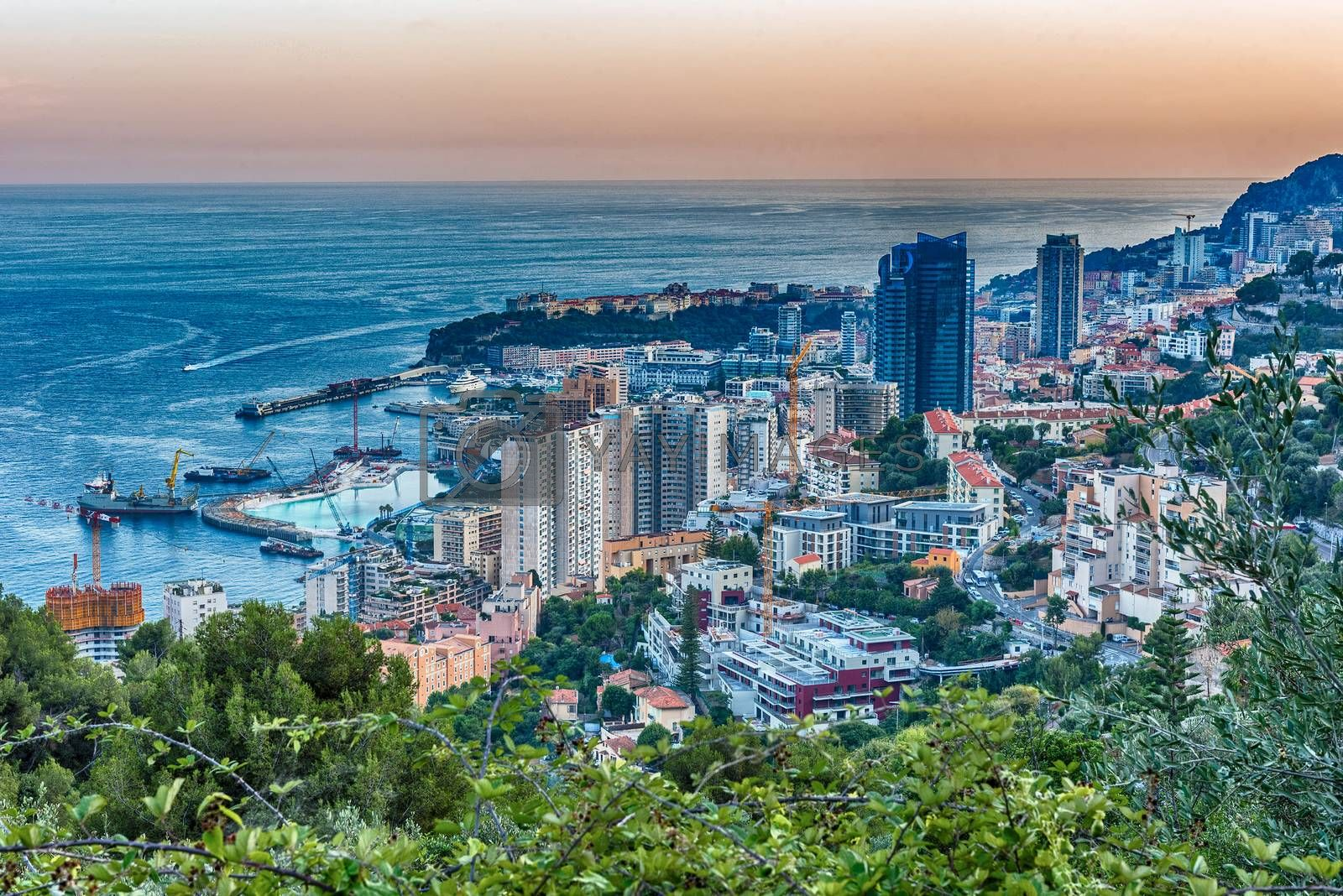 Panoramic view of Monaco at sunset from the Grande Corniche road, iconic landmark in Cote d'Azur, French Riviera