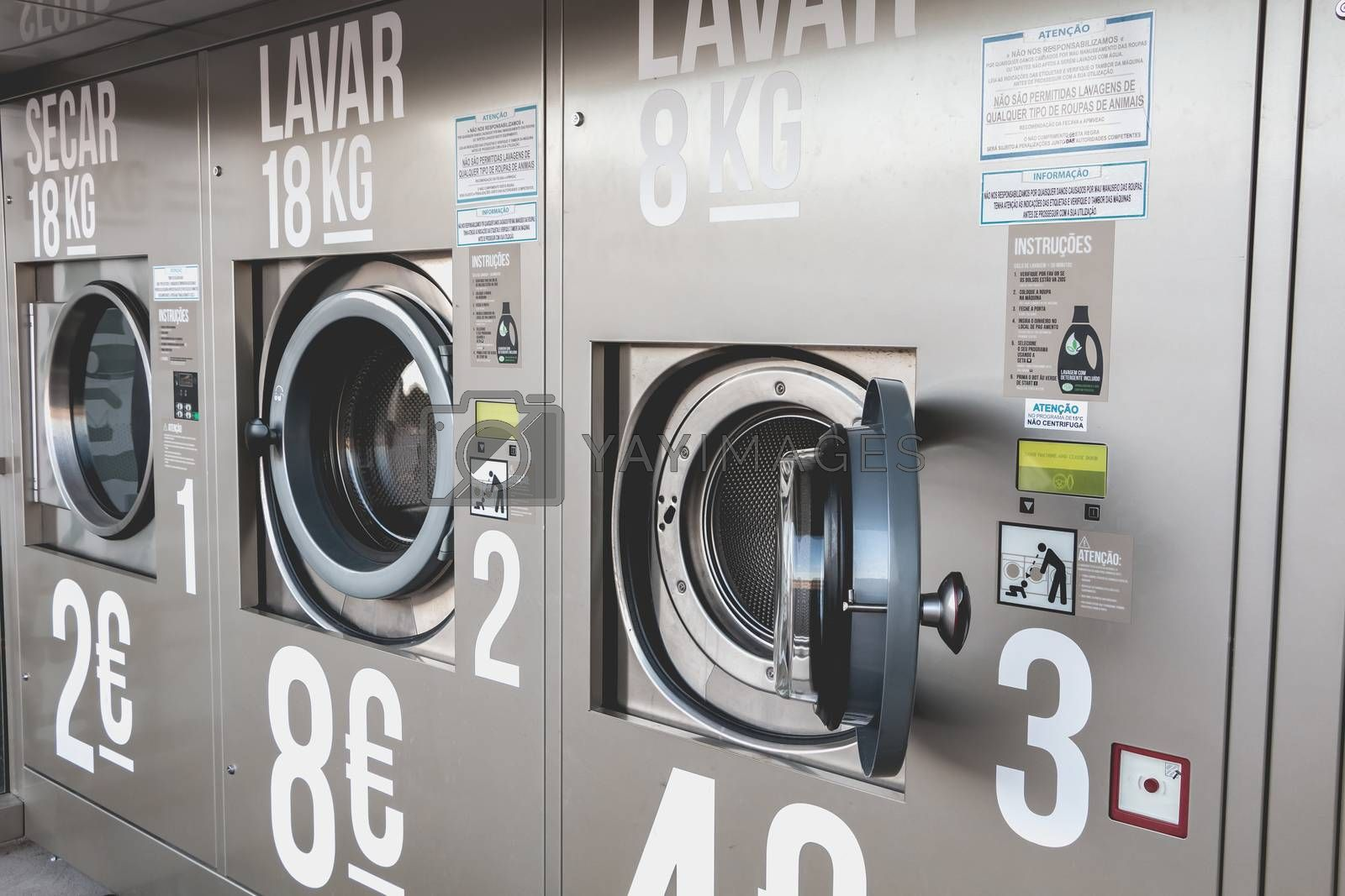 Albufeira, Portugal - May 3, 2018 - View of an automatic public washing machine in the city center on a spring day