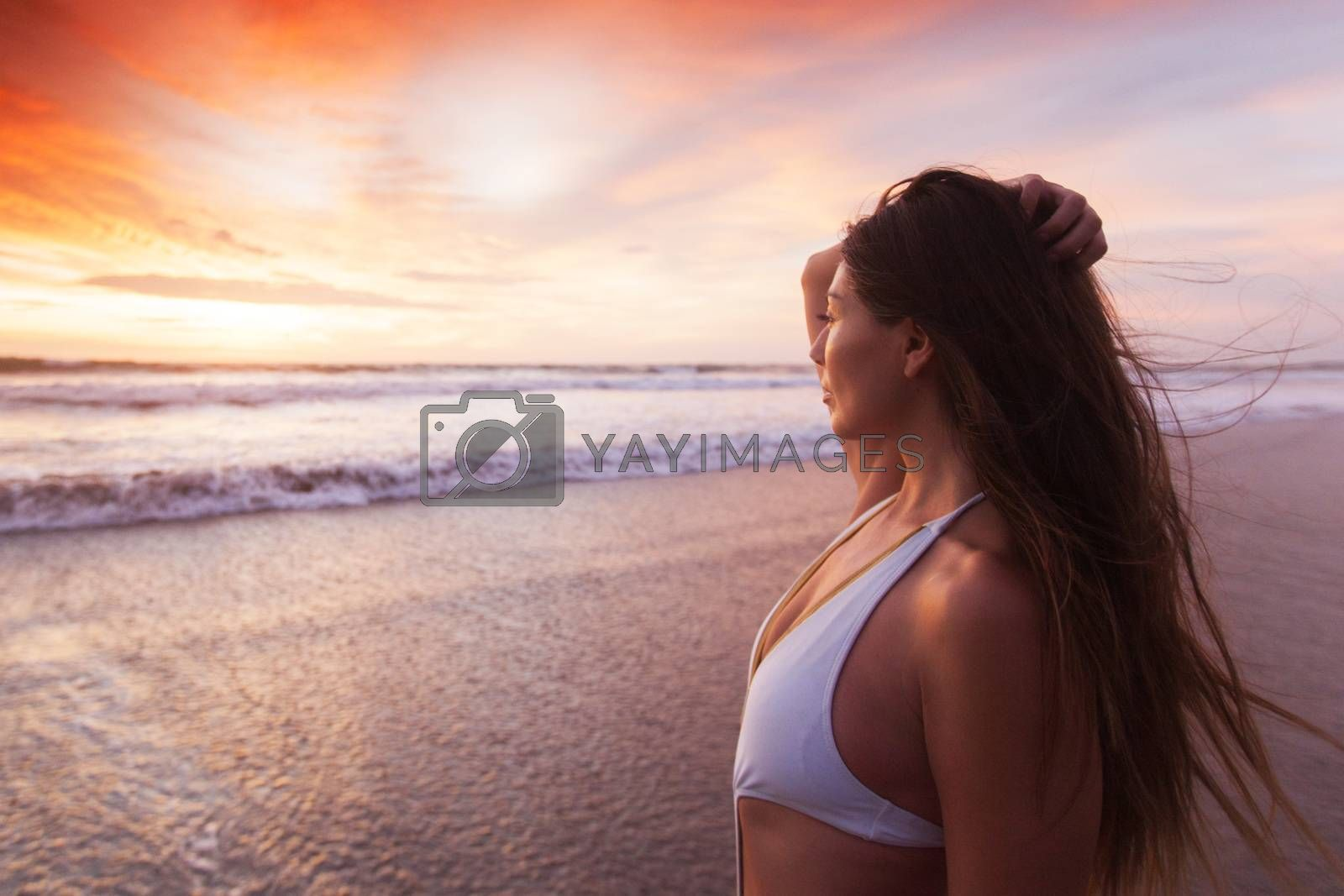 Beautiful fit woman on beach look at sunset time sea summer vacation