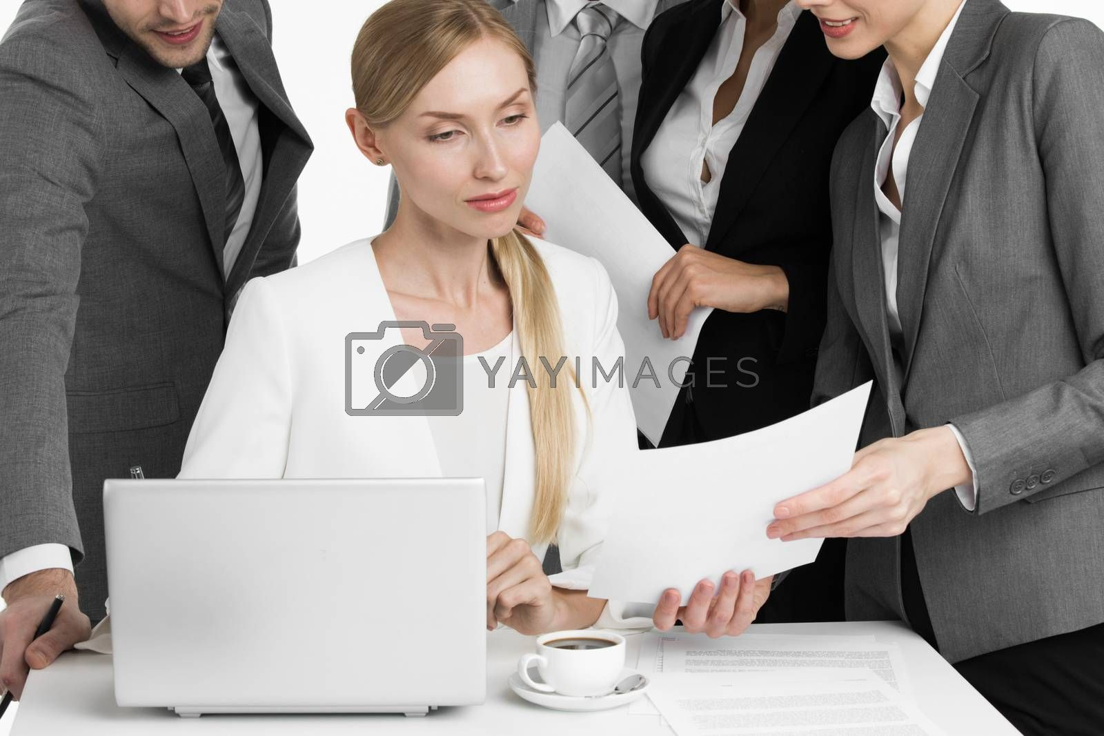Business people working in office. Smiling business men handing over documents to businesswoman