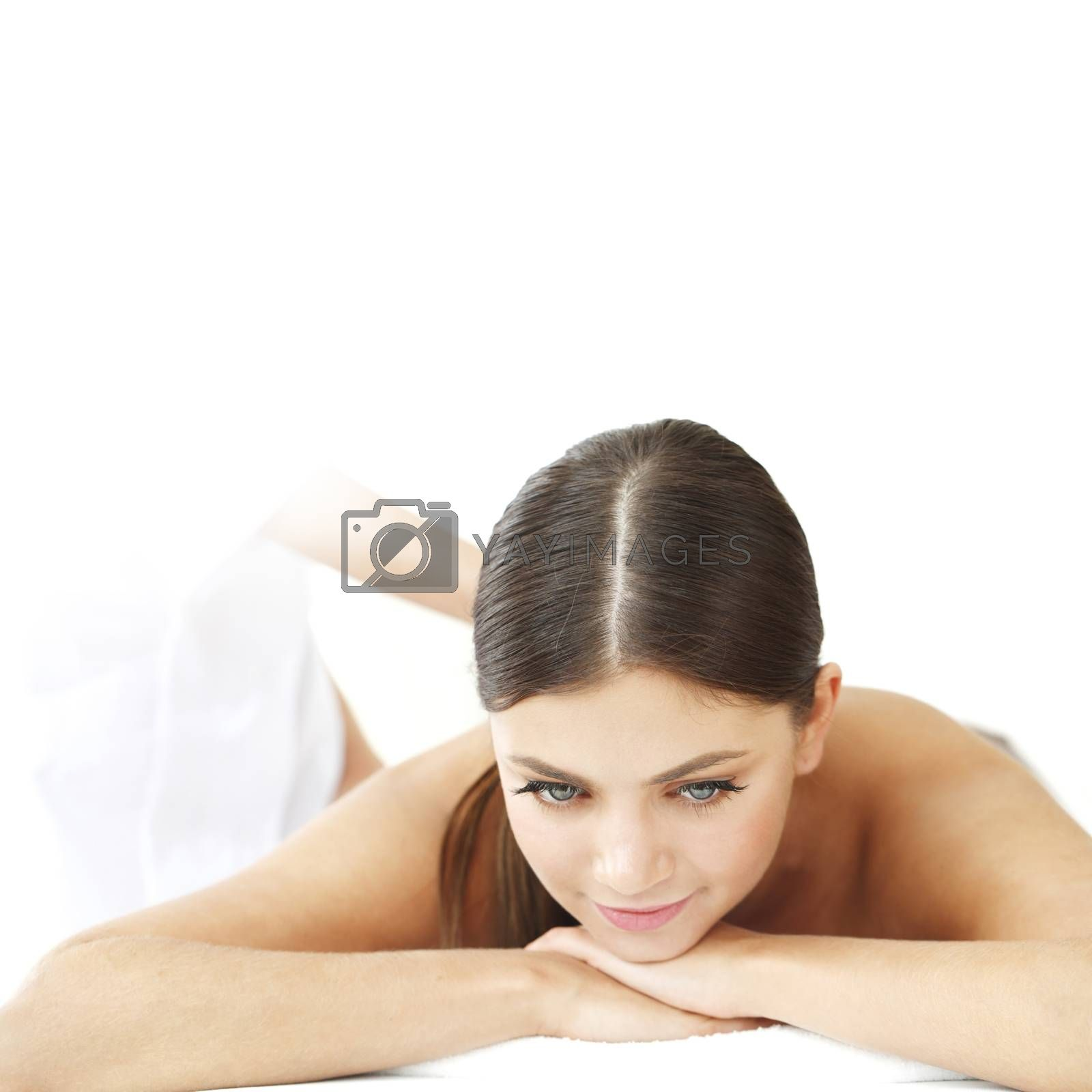 Smiling woman enjoying massage in a spa center