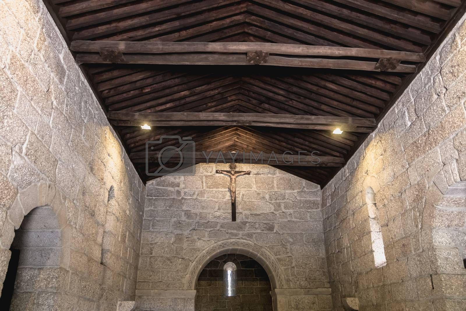 Guimaraes, Portugal - May 10, 2018: architectural detail of the Chapel of St. Michael next to the castle of Guimaraes that tourists visit on a spring day.