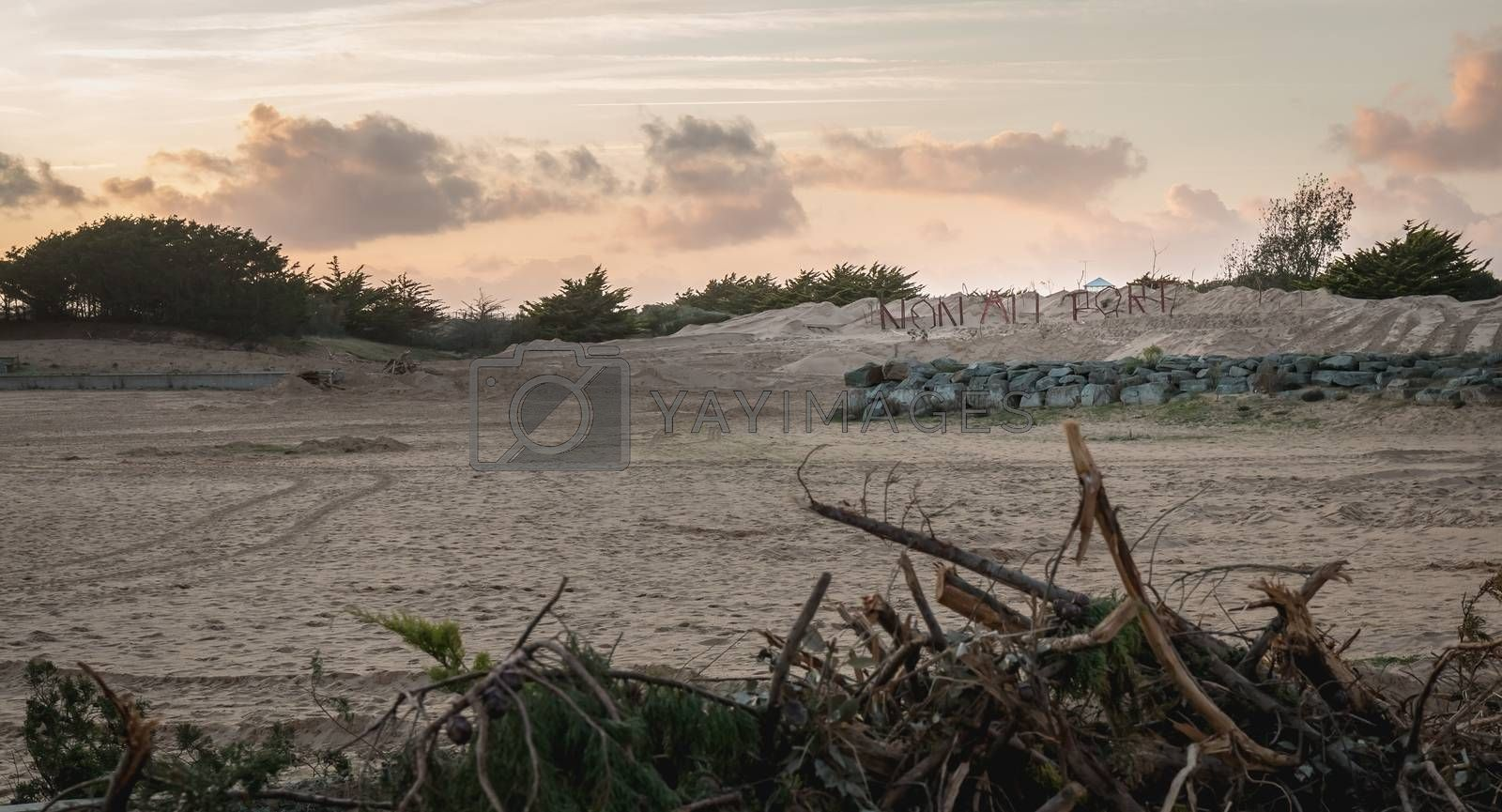 Bretignolles sur Mer, France - October 9, 2019: No to the Port in French made in log on a ZAD (Acronym of Zone to Defend) protest zone against the construction of the boat harbor