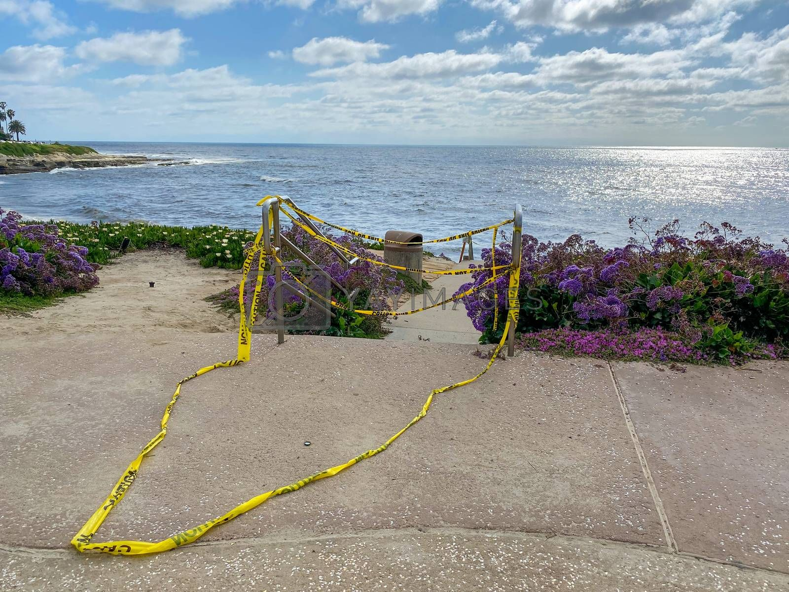 CClosed beach of La Jolla with informative signage during COVID-19 pandemic. Coronavirus virus panic and quarantine San Diego, USA, April 18th, 2020