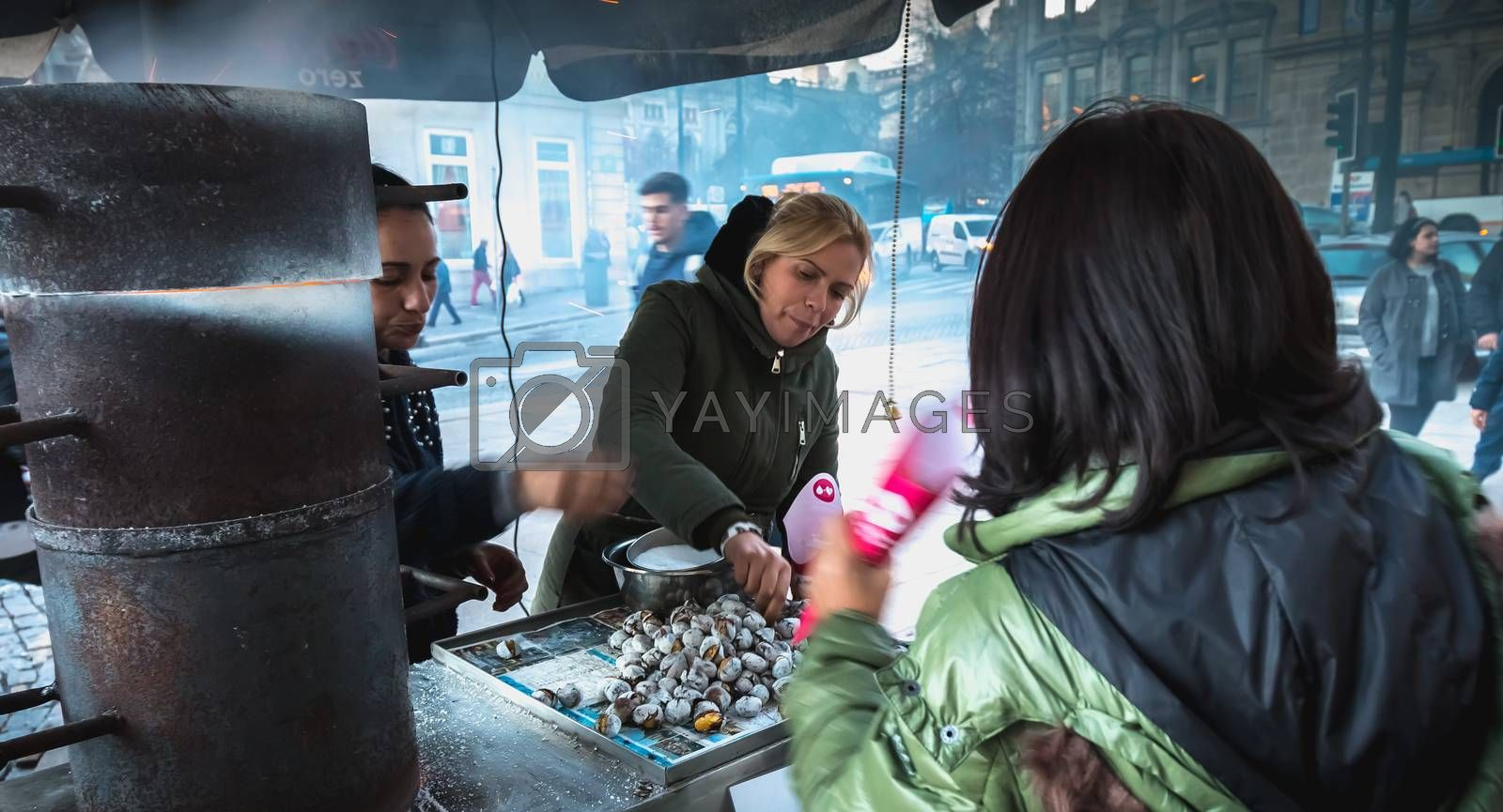 Street vendors of braised chestnuts in front of Sao Bento statio by AtlanticEUROSTOXX
