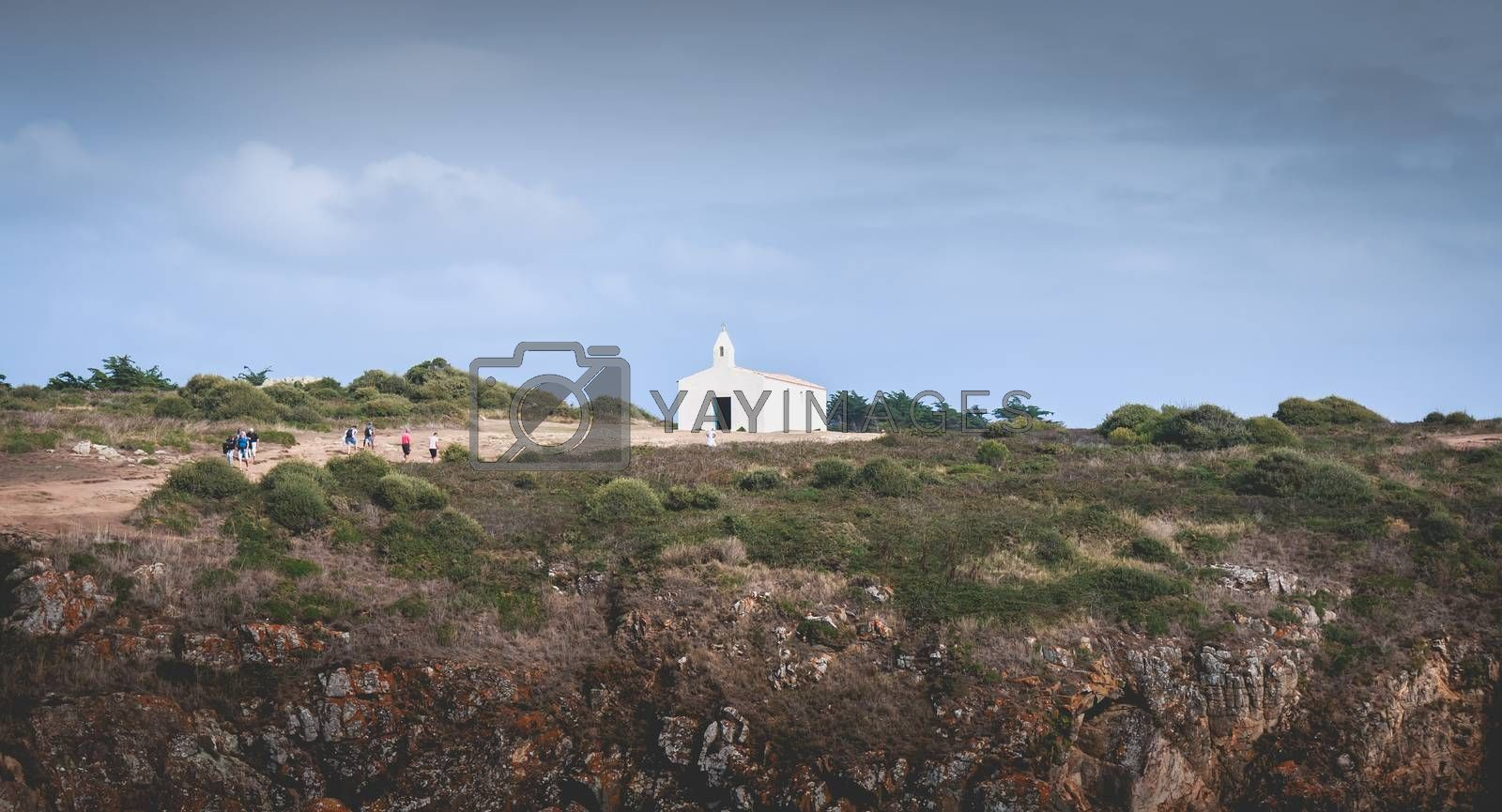 Tourists visiting the surroundings of La Meule chapel near islan by AtlanticEUROSTOXX