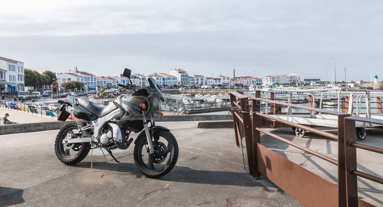 Motorcycle parked in harbor port Joinville on Yeu Island by AtlanticEUROSTOXX