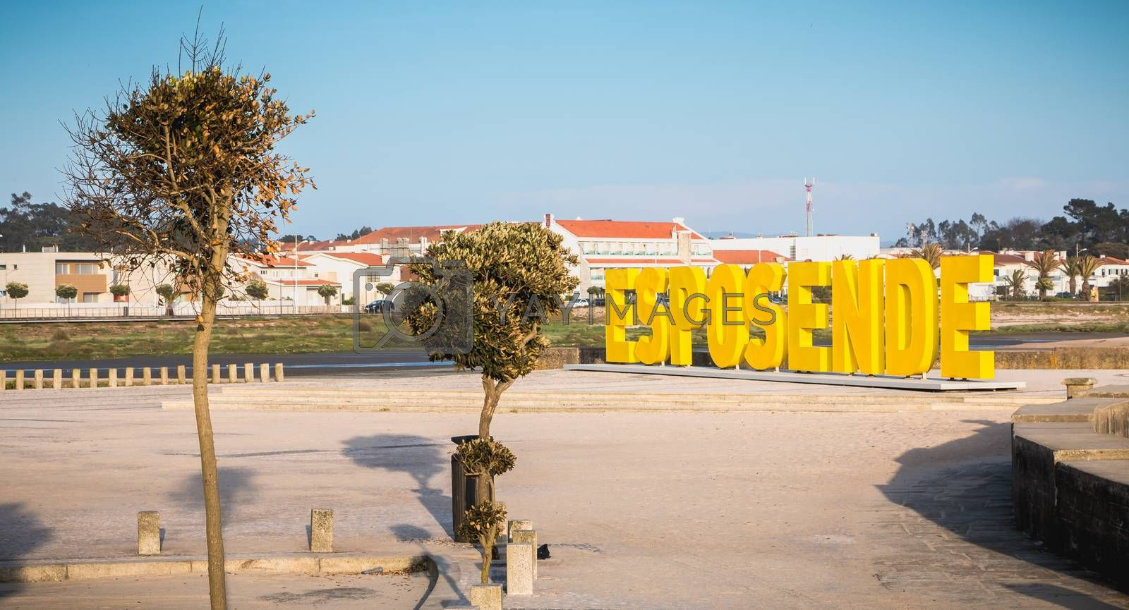 Esposende, Portugal - May 8, 2018: Big yellow block letters spelling Esposende on the beach on a spring day