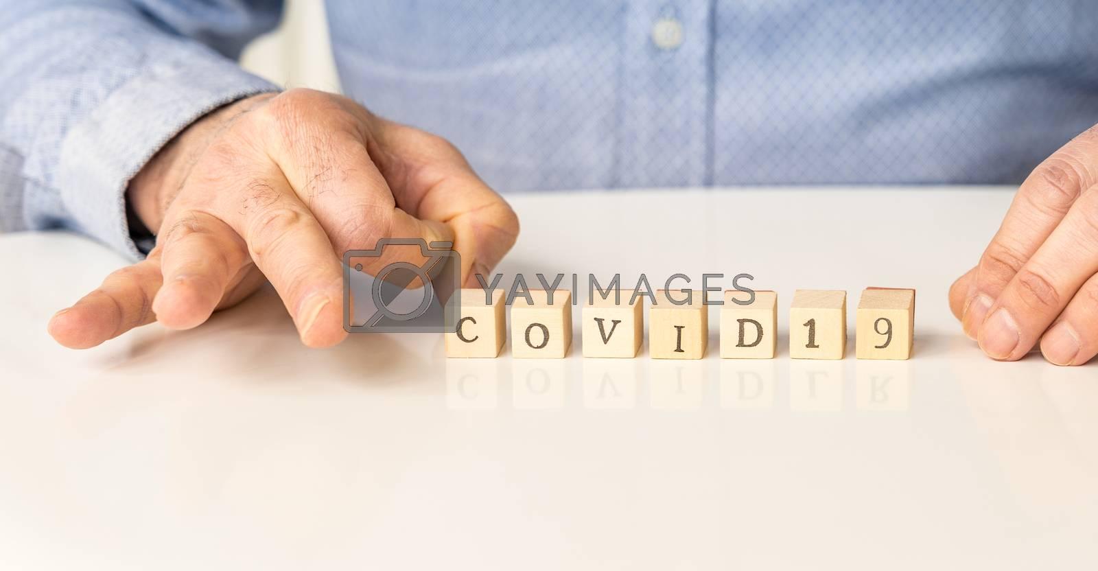 Covid 19 and coronavirus disease conceptual image on wood.