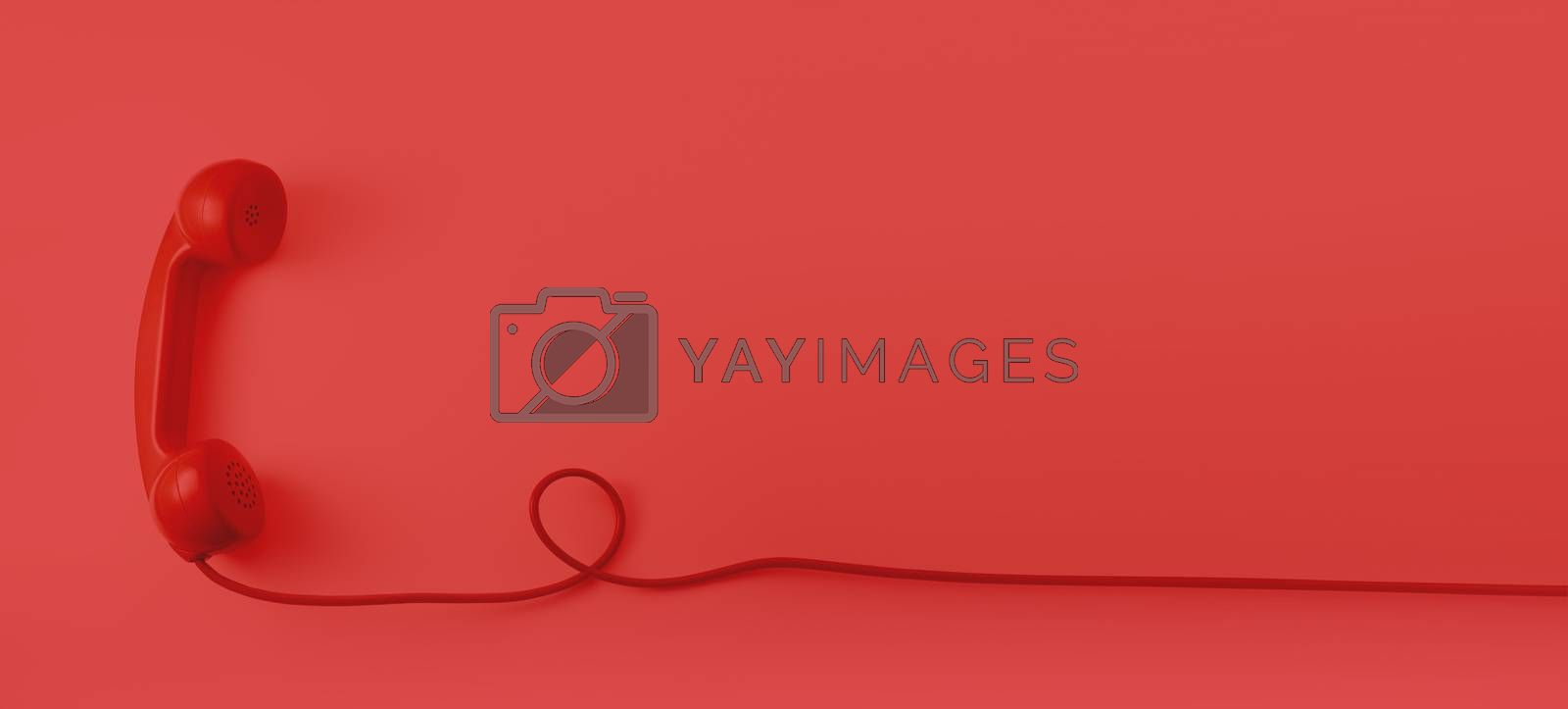 A red vintage dial telephone handset with red background.