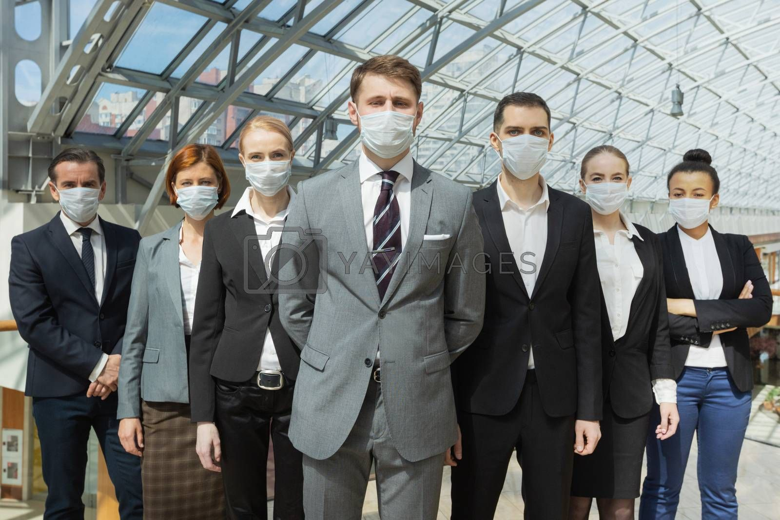 Business people wearing surgical protective masks and standing together, healthcare and covid-19 prevention concept