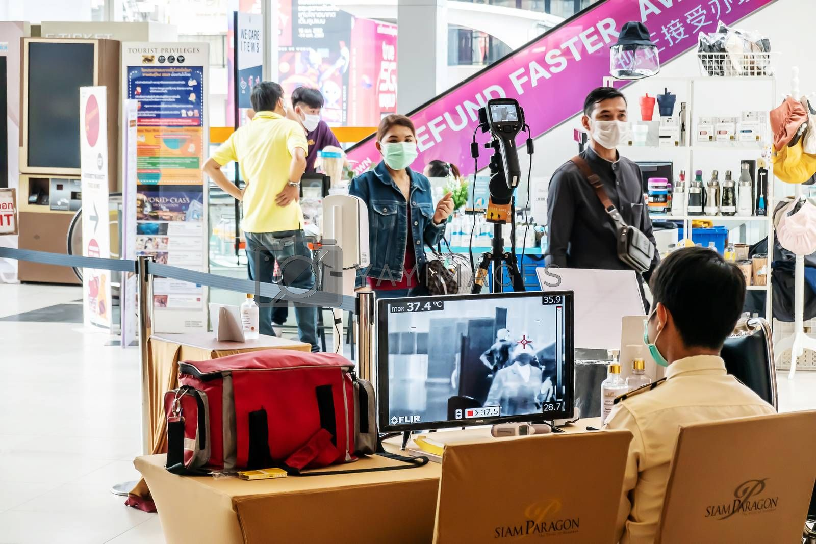Bangkok,Thailand - April 07 2020. Temperature control zone, monitor of thermal scanner camera to check people entrance of Siam paragon shopping mall in Bangkok during Coronavirus, Covid 19 outbreak.